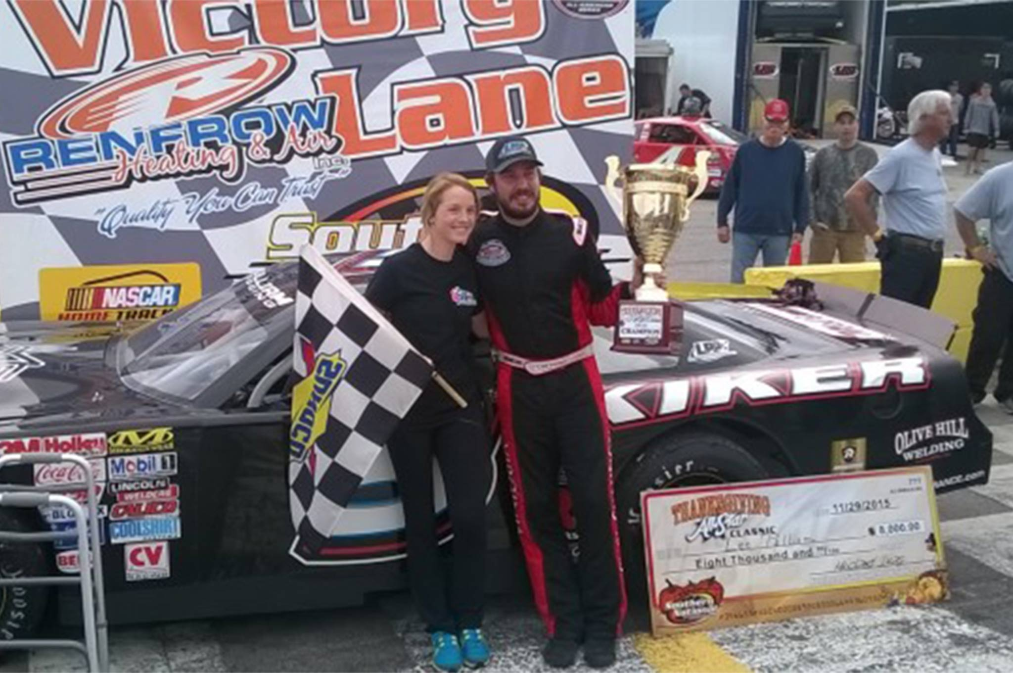 Lee Pulliam and his wife LeAnne celebrate a win at SNMP after a week of adversity.