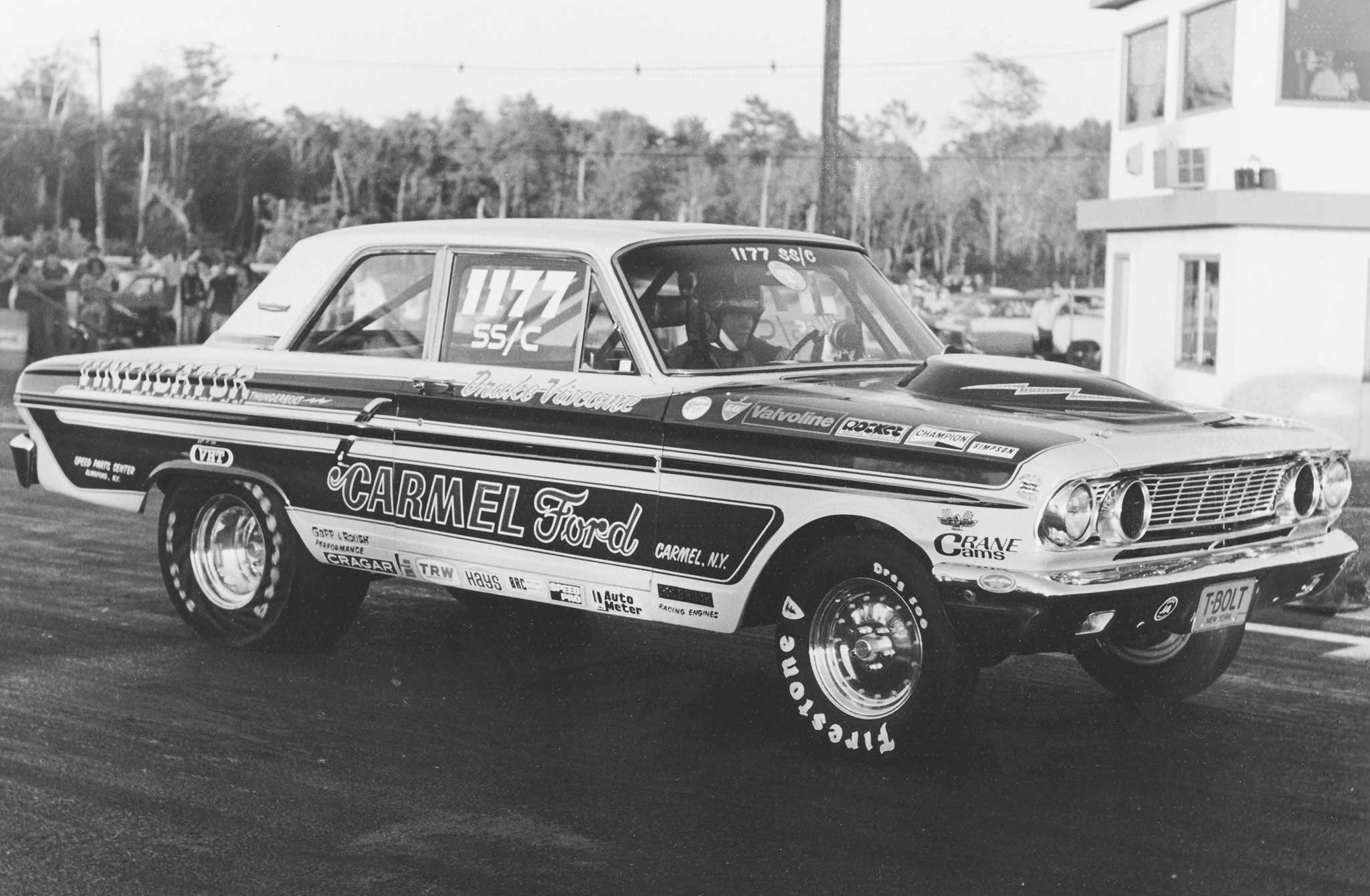 Ford's racing group wanted to put 427-powered Fairlanes in the lineup for Grand National racing. When NASCAR said no, Ford promptly set loose its Medium Riser Fairlanes on dragstrip tarmac. Here Drake Viscome gets a hat in his Vindicator SS/C Thunderbolt.