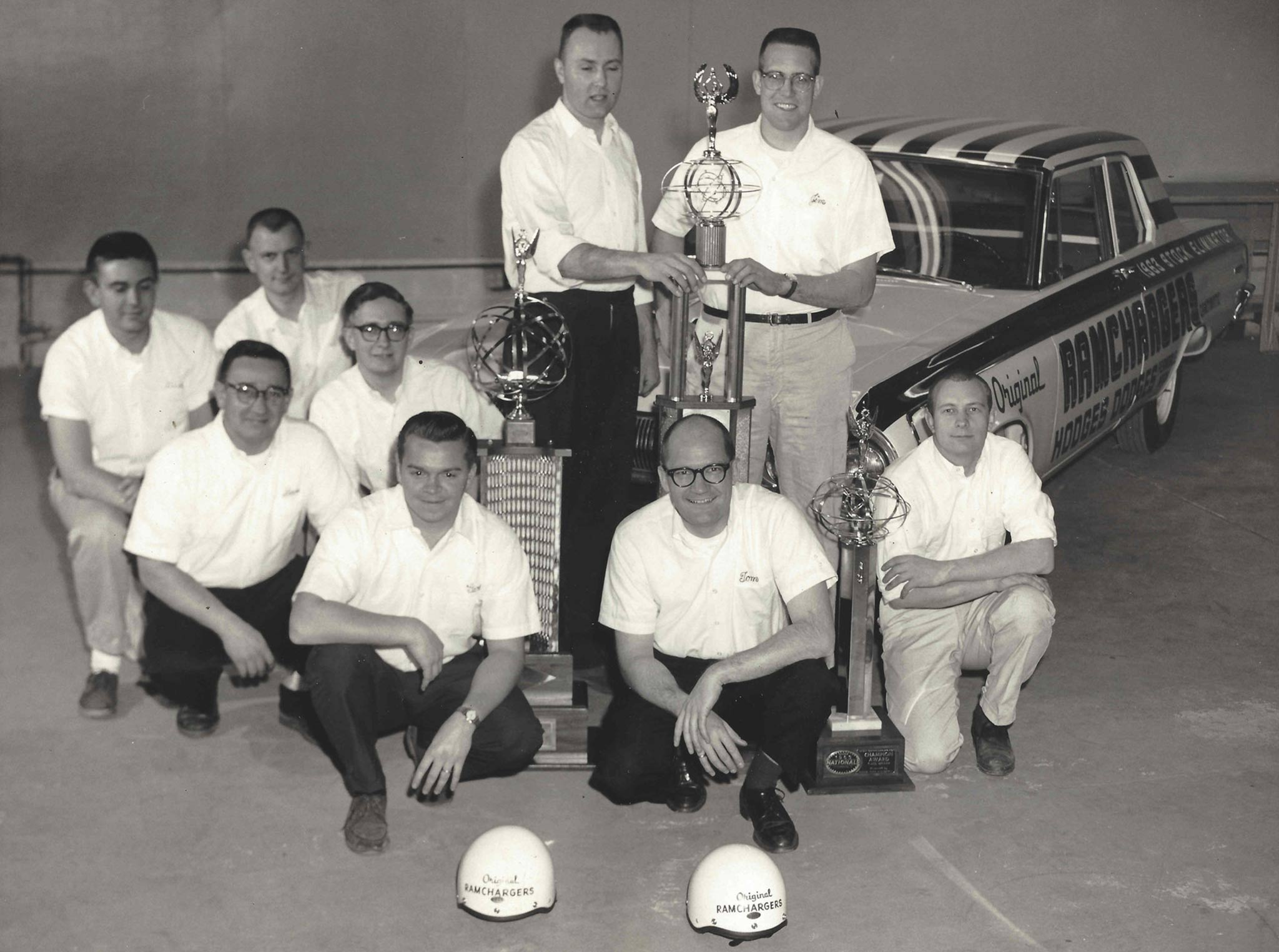 The Ramchargers team with the spoils of victory that same year. From left to right, standing: Herman Mozer and Jim Thornton; kneeling: Dick Maxwell, Dan Mancini, Mike Buckel, Tom Coddington, Gary Congdon, Tom Hoover, and Dale Reeker.
