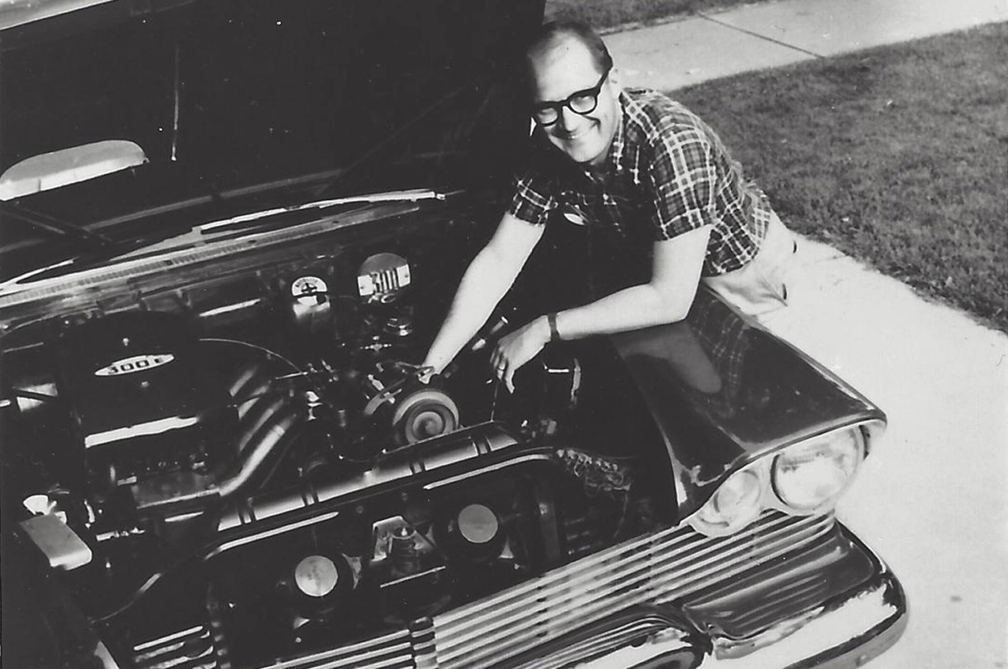 Tom with his 1957 Plymouth convertible and the EX32 392ci Hemi engine. This car featured a unique experimental ram outfit with four short tubes on one engine bank and four longer versions on another; it worked well enough to set the NHRA record in C/Gas in 1960.