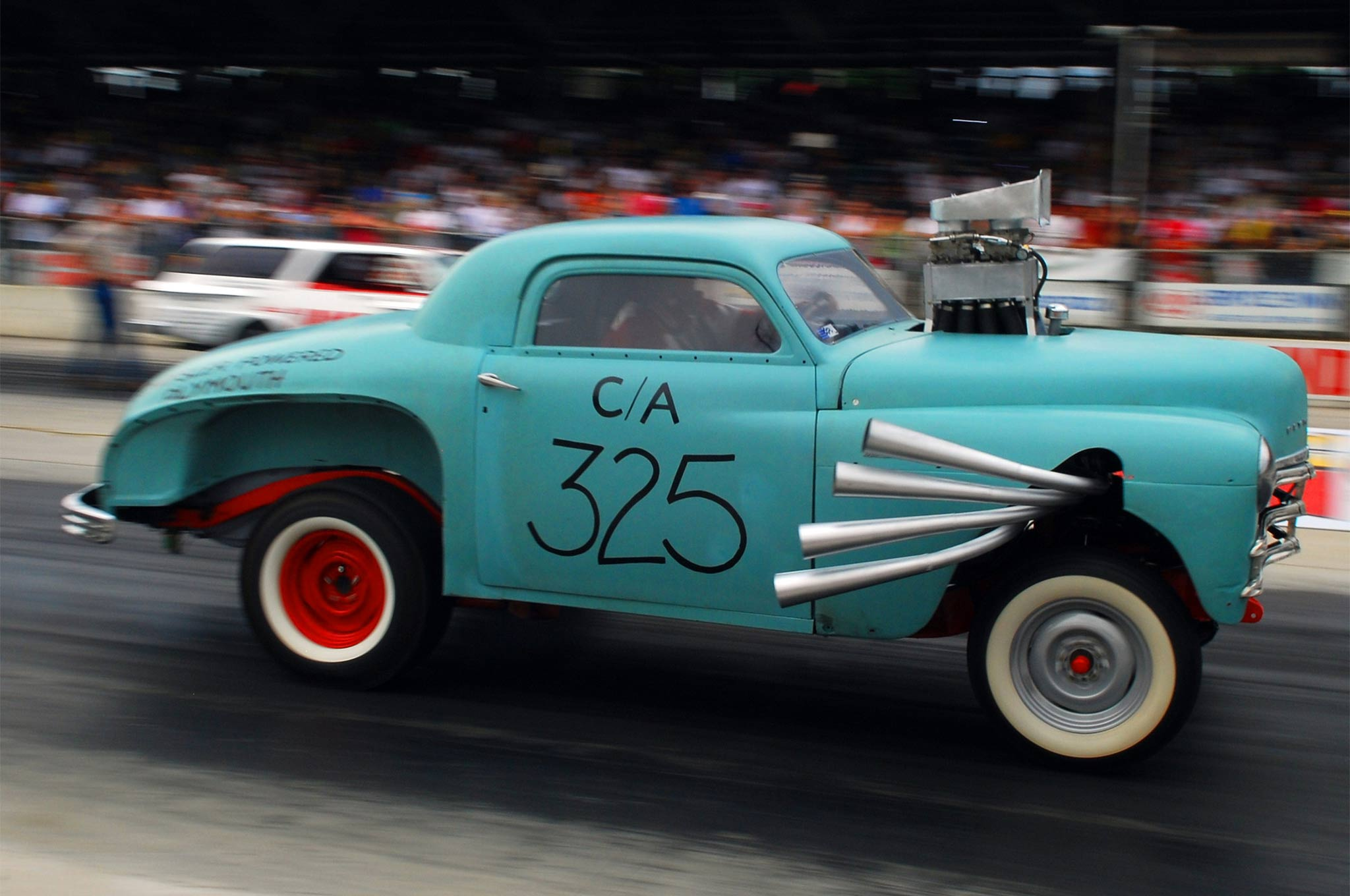 The Ram Rod became the High & Mighty in 1960, before NHRA lowered the boom (and the crank centerline). This tribute car did exhibition runs at Bowling Green the year the Ramchargers were honored.