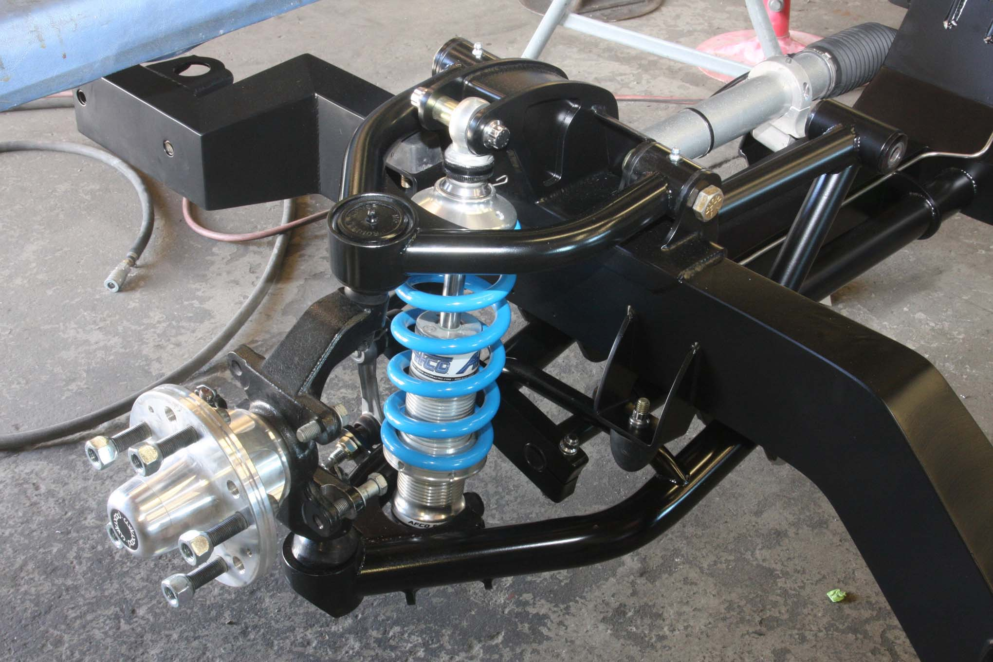 Here the Roadster Shops front suspension has been fitted with Wilwood's aluminum hubs. The coilovers are from AFCO.