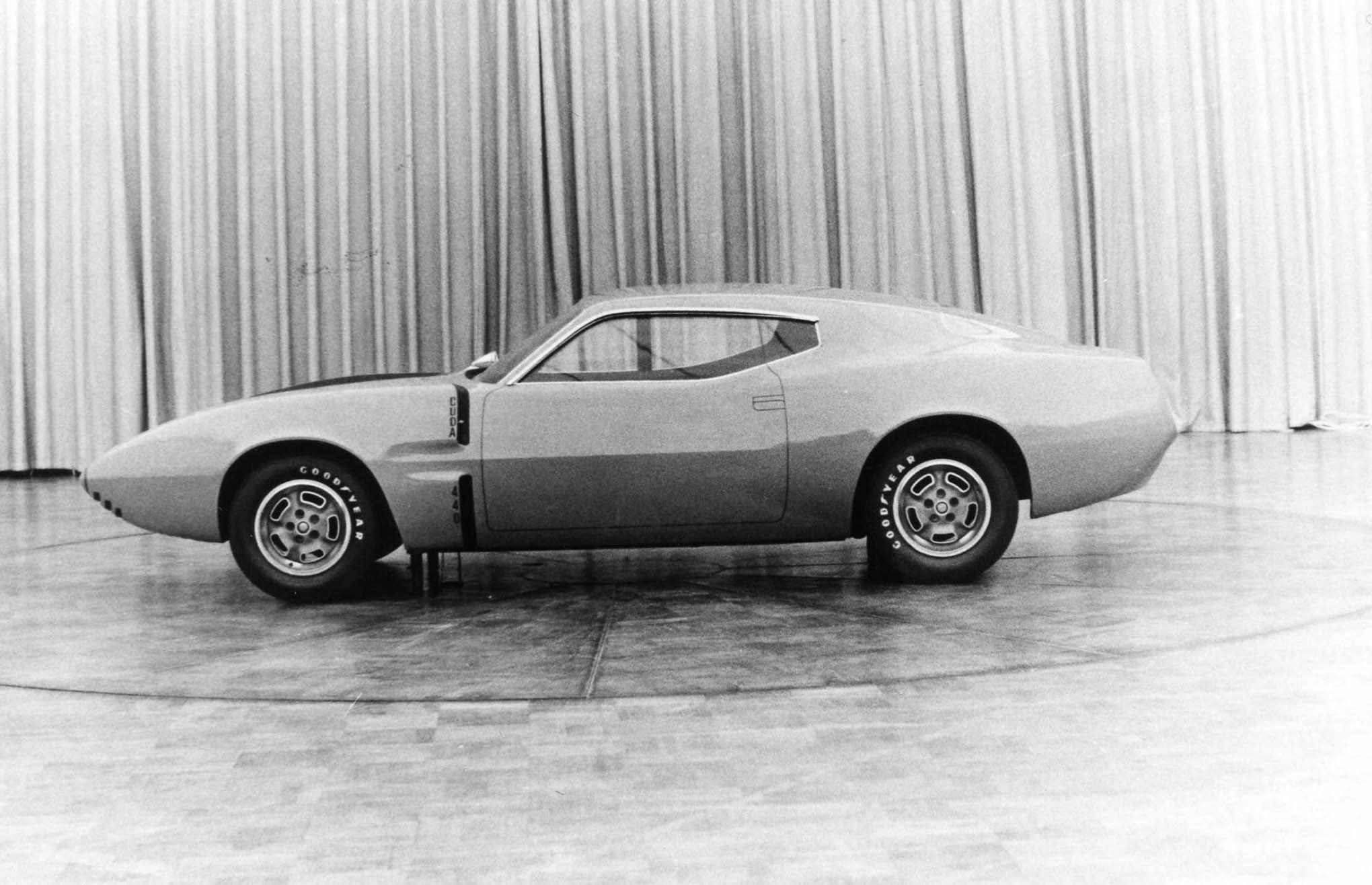 "This clay, on display in the Plymouth styling studio on May 2, 1969, combines elements from both the Matsurra and Herlitz/Sampson proposals. The quarters are not as high as before, with a strong character line along the car's mid flanks. The wheel openings are tall and round. On the driver's side profile is the hint of a quarter window. The front fender air extractors are trimmed in black and read ""CUDA"" on the upper and ""440"" on the lower. Sharp-eyed Mopar fans will notice the two-piece W23 lightweight road wheels that were recalled in 1969 for cracking almost before they were released."