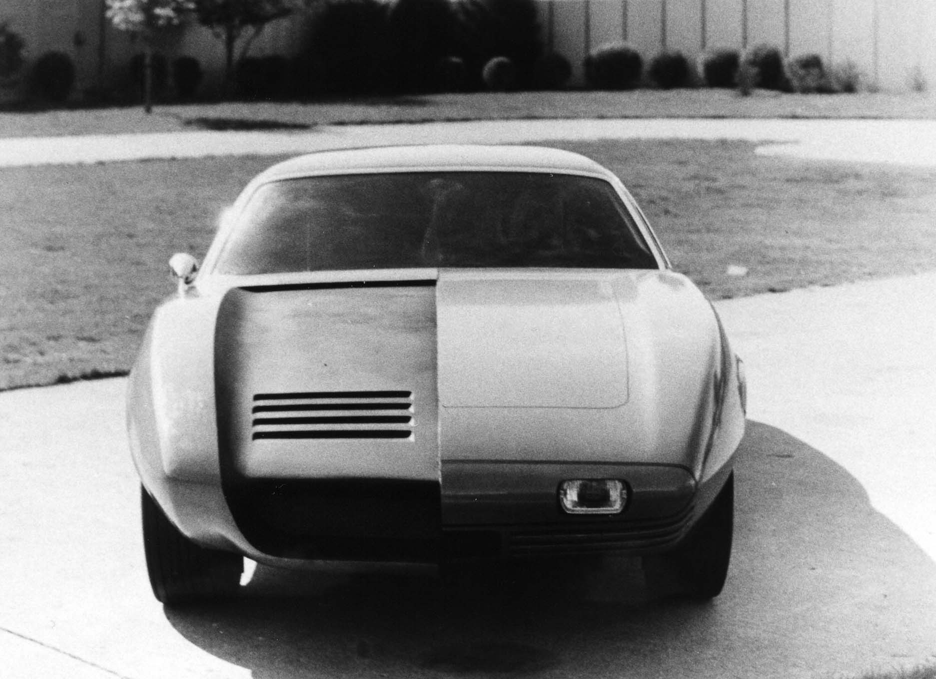 This is the front end of the same clay, now outside in the styling studio's courtyard on May 2. Two different hood and grille proposals were shown. The large opening at the valance on the right side included a concave hood. The left hand side has a more traditional hood line, tipped with a bumper that has a recessed fog lamp. This angle illustrates how the driver's side fender also bulges out farther over the wheel opening.