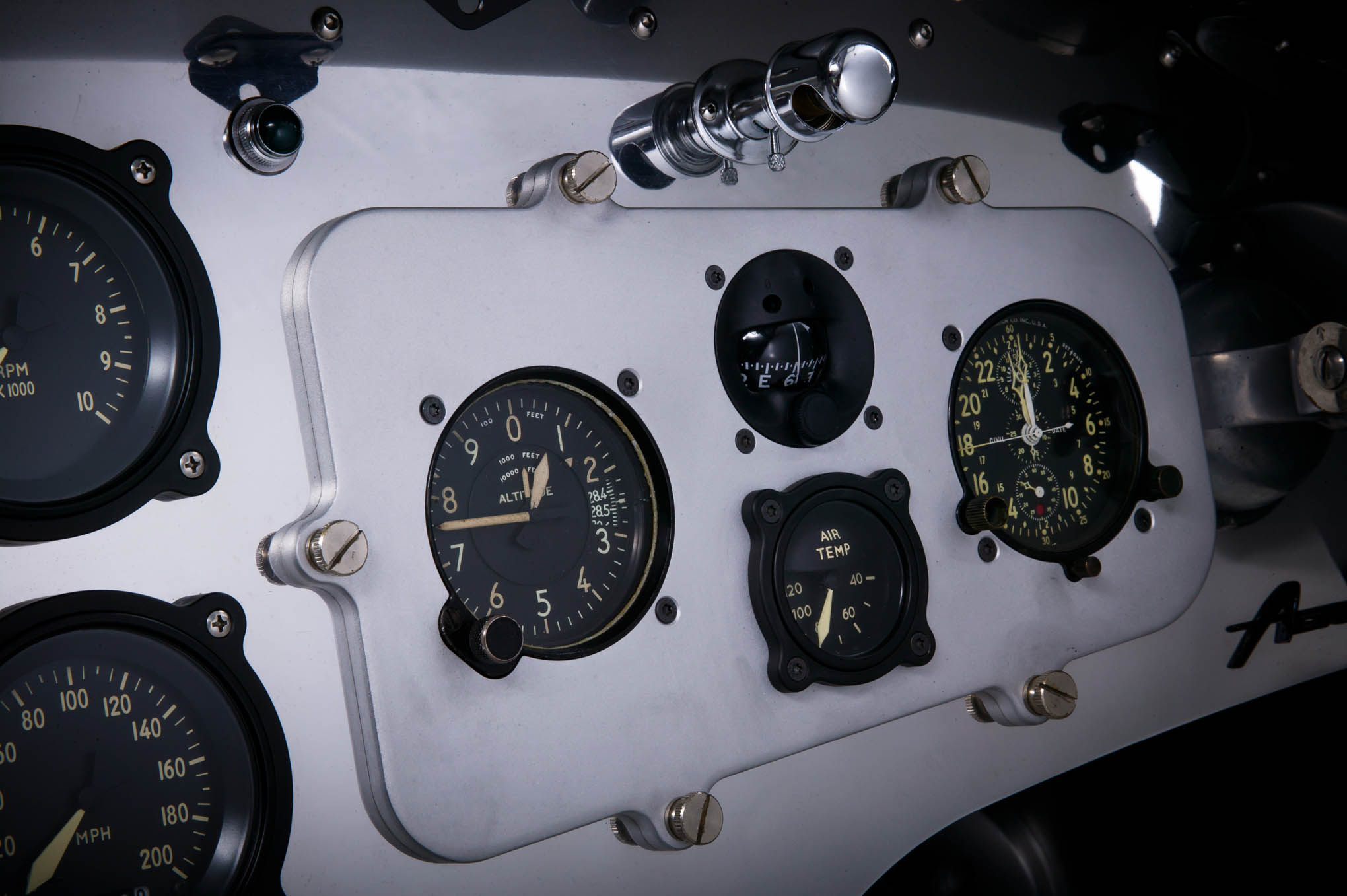 The Moal-built aluminum panels are reminiscent of aircraft style, then outfitted with Classic Instruments custom Moal Bomber gauges. You gotta drool over the temp gauge (water and oil), left and right boost gauge, oil psi, and a pair of EGT (exhaust gas temperature) built into one unit.