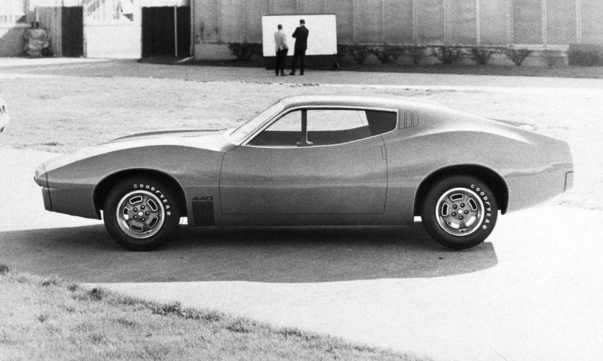 Don Hood had left GM in 1968 to join the Plymouth Styling Studio. His clay, shown on May 2, 1969, showed a lower rocker and more radiused wheel openings. The strong ramps on the front fenders and the rear quarters impart a balance with equal overhang at both ends.