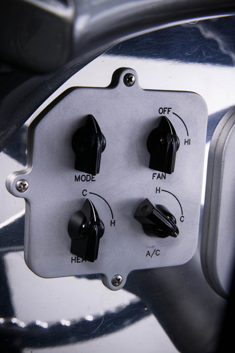 A volt and amp gauge sits directly above another real-deal in the ignition sequence panel. And way down at the bottom is a fuel and a fuel pressure gauge.