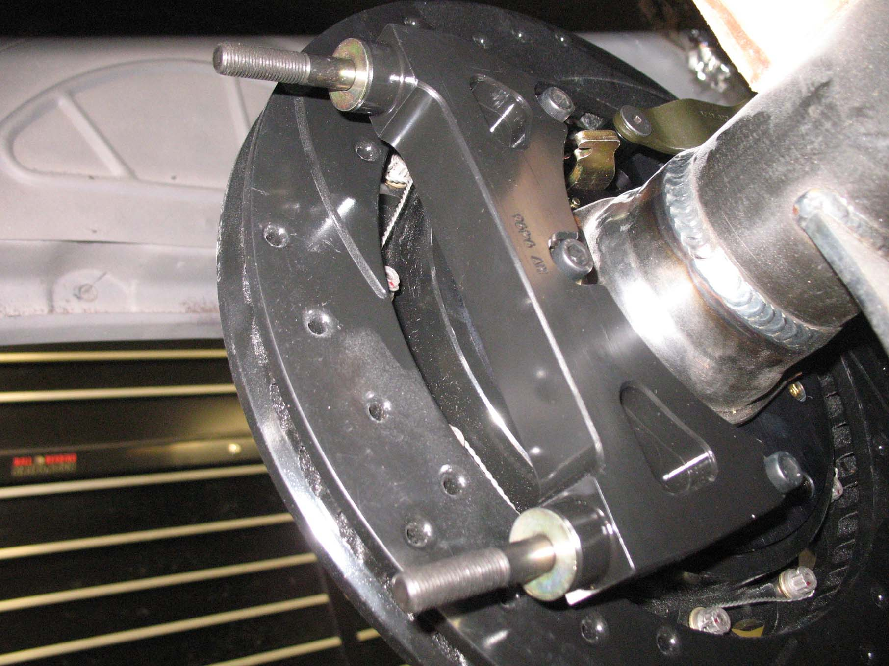 As in the front, radial caliper mounts are used. Note the shims that have been installed on the studs.