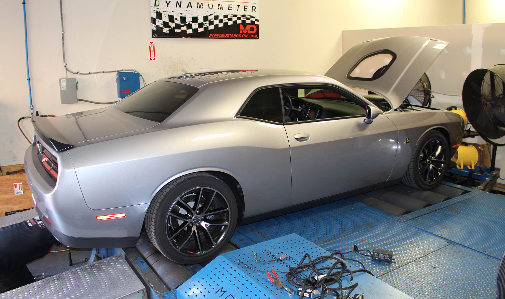 We packed our Trinity tuner and drove the 392 Hemi Challenger to Tune Time Performance (TTP). There we'll learn the bone-stock, stock-tune, and after-headers power numbers. Our bone-stock number was 371 hp at the wheels. (You'll remember our press car tested at 432 rearwheel horsepower to the wheels on a Dynojet.) That sounds low compared to other Scat Packs because TTP's Mustang dyno will show 10 to 12 percent less power.