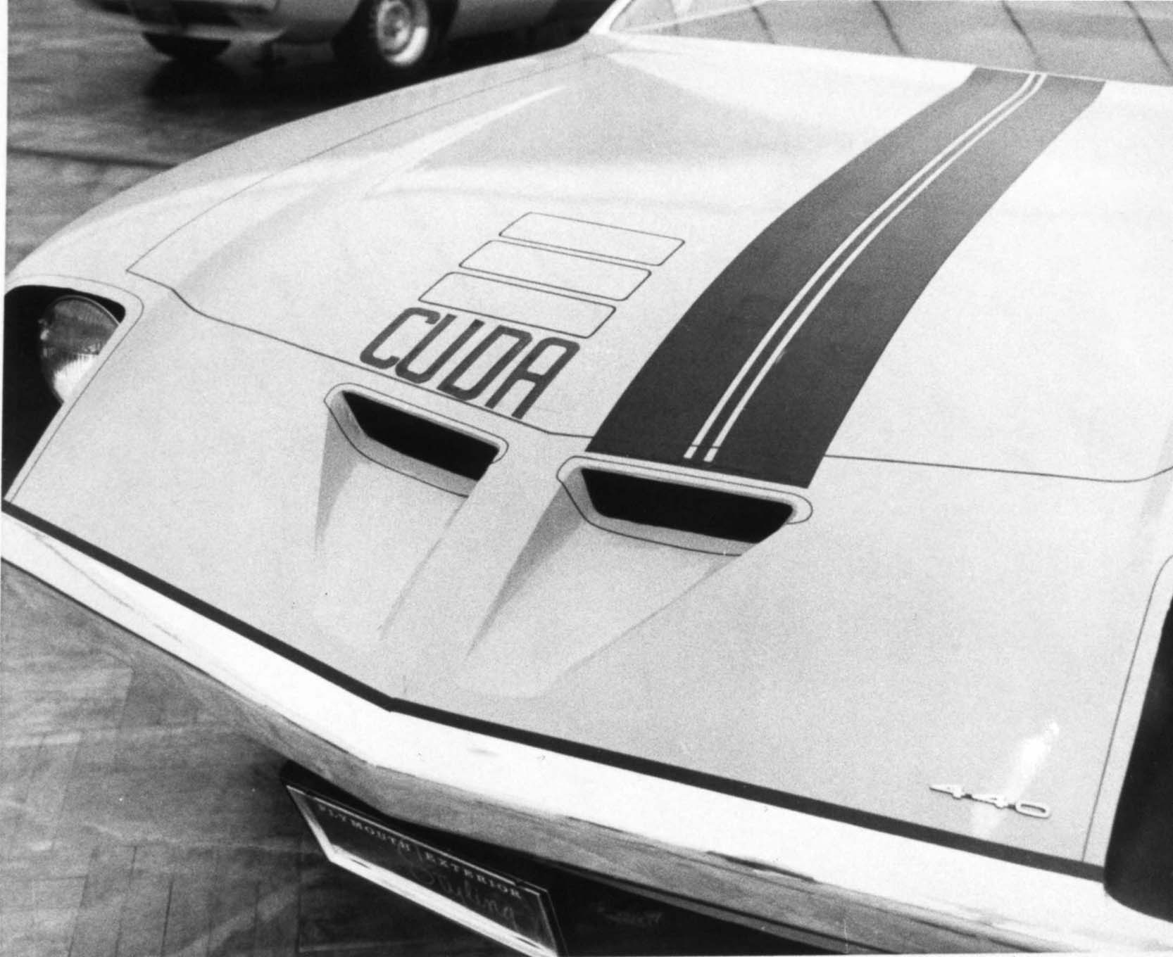 Hood's front-end proposal included functional air intake scoops. Several approaches were tried, including recessed and hidden headlights, stripes and decals. Note the 440 emblem on the header panel.