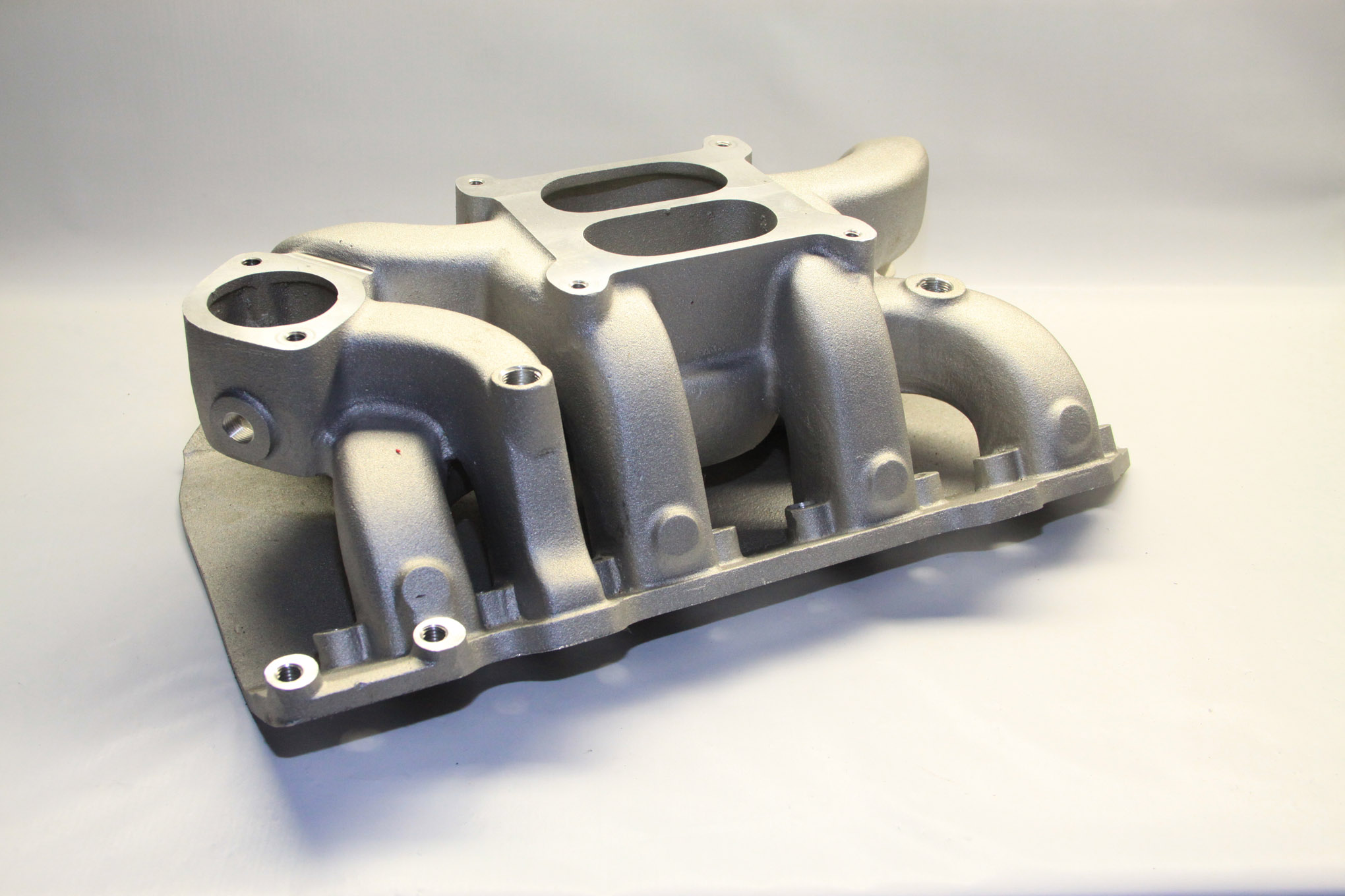 We had planned on using one of Roland Osborne's new Polysphere intake manifolds (polysuperpac.com; 888-548-2282), but it was too tall to fit under our '60s hood.