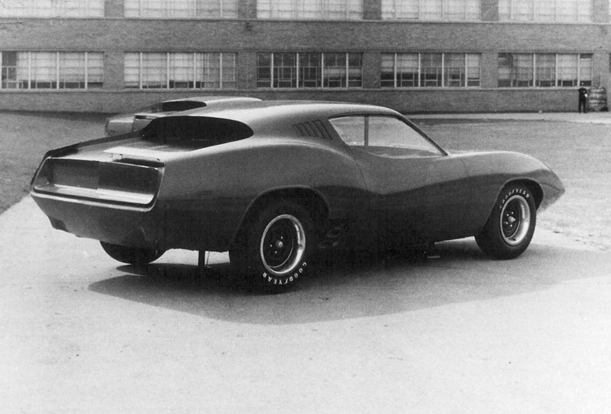 Another never-before-seen image from the Chrysler design archives of the 1975 Plymouth Barracuda concept outdoors at the design center.