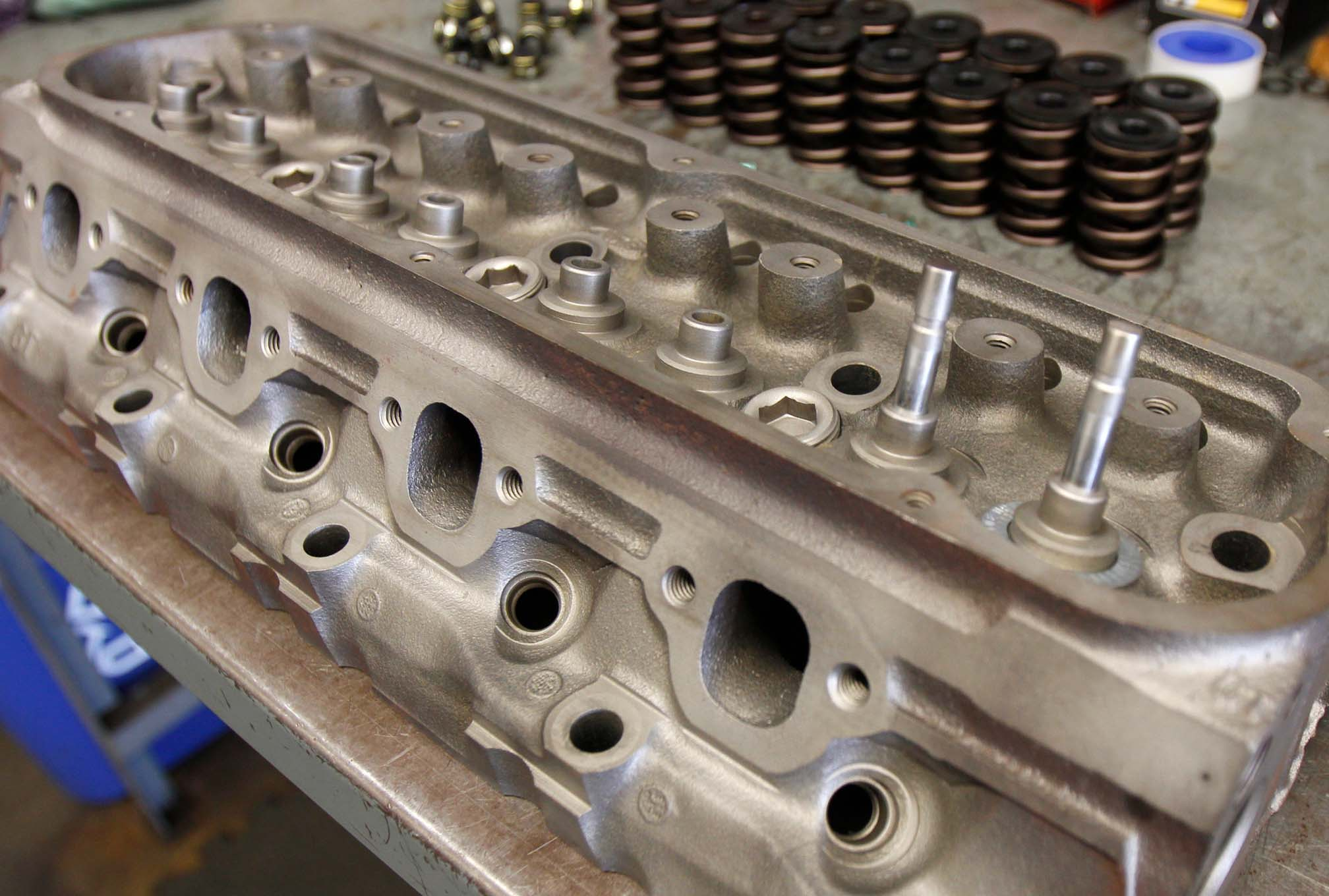 Though the stock GT40 heads were untouched (no machining, valve job, or porting), we installed Trick Flow's spring kit, which is needed because of the B303 cam's increased valve lift. In stock form, the exhaust valves had rotators installed underneath retainer; they are thick and bulky and will collide with the valve-guide boss at more than 0.450-inch valve lift. Trick Flow's kit includes higher-rate valvesprings and retainers that fit differing installed heights of the stock intake and exhaust valves. Once installed, you can safely run up to kit 0.542-inch lift with the stock valves. This is a much less expensive option than replacing all the valves.