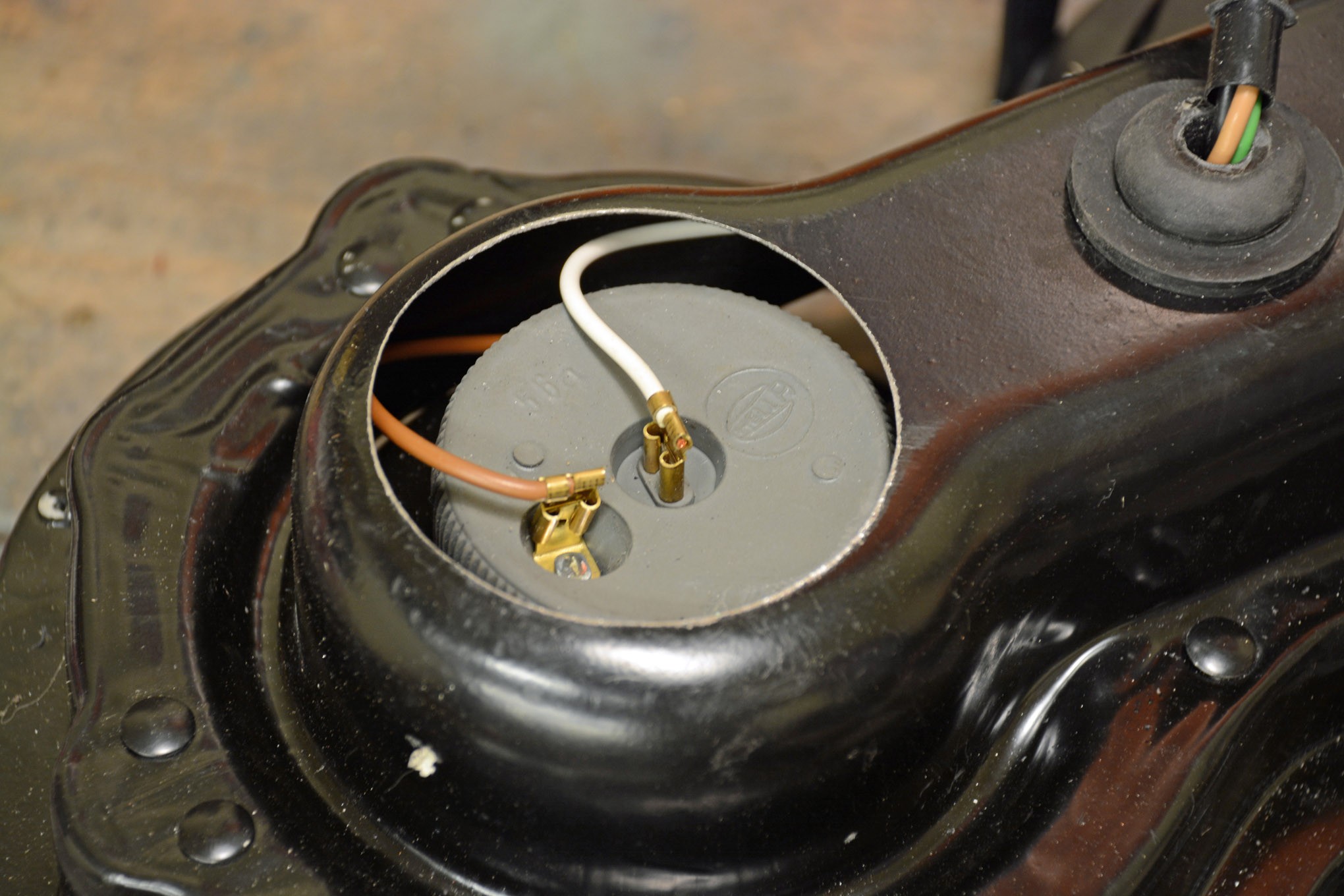 The halogen bulb connectors protrude through the rear of the rubber boot on the light. We didn't like the idea of the wires being exposed to the weather and felt a cover was in order. Note the wiring plugs into the original style seal beam plug.