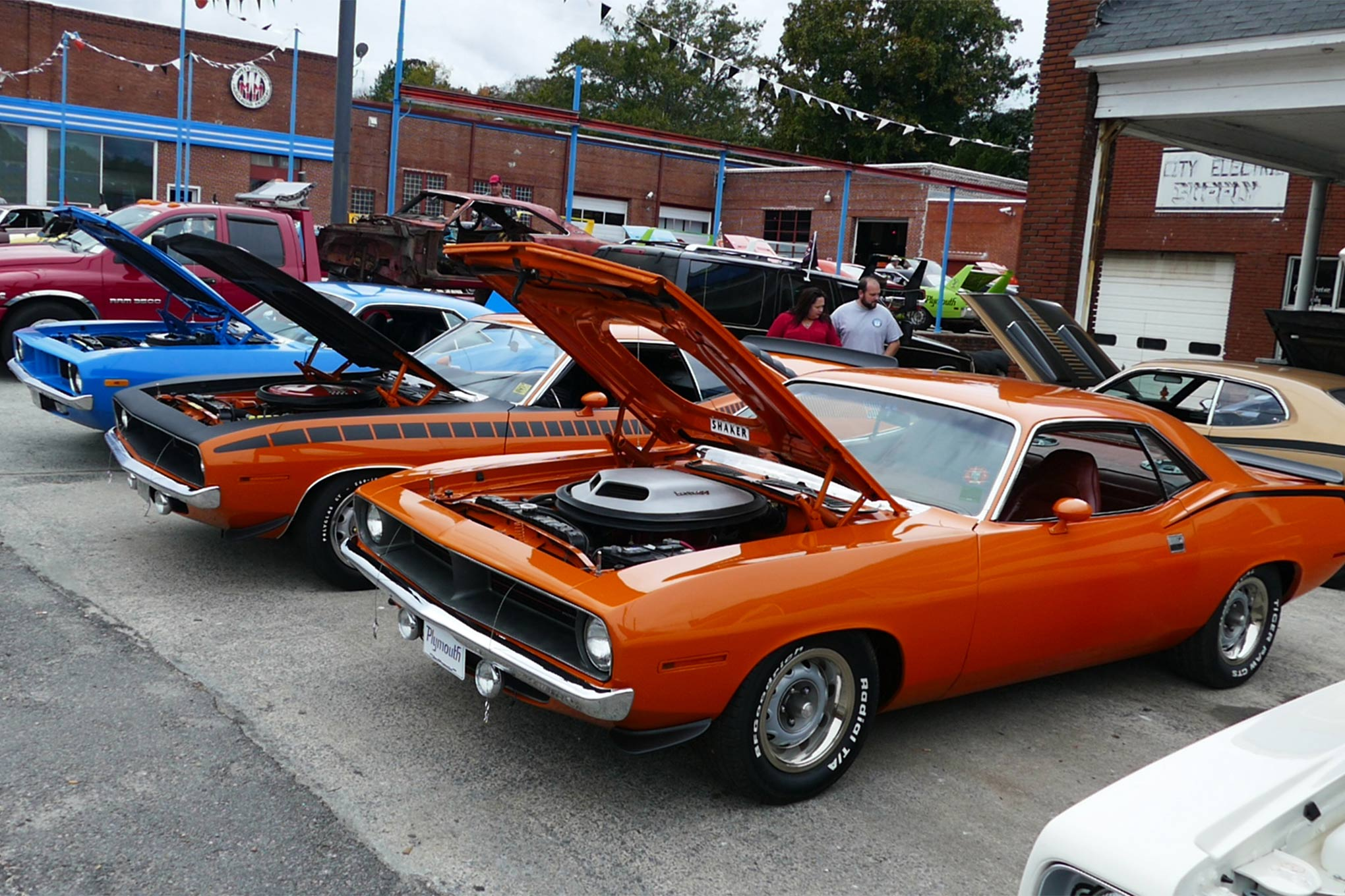 The side lot of the Wellborn Musclecar Museum was filled with cars on Saturday morning, as was the front lawn and main lot of the old dealership and the former Uniroyal/auto-repair business next door.