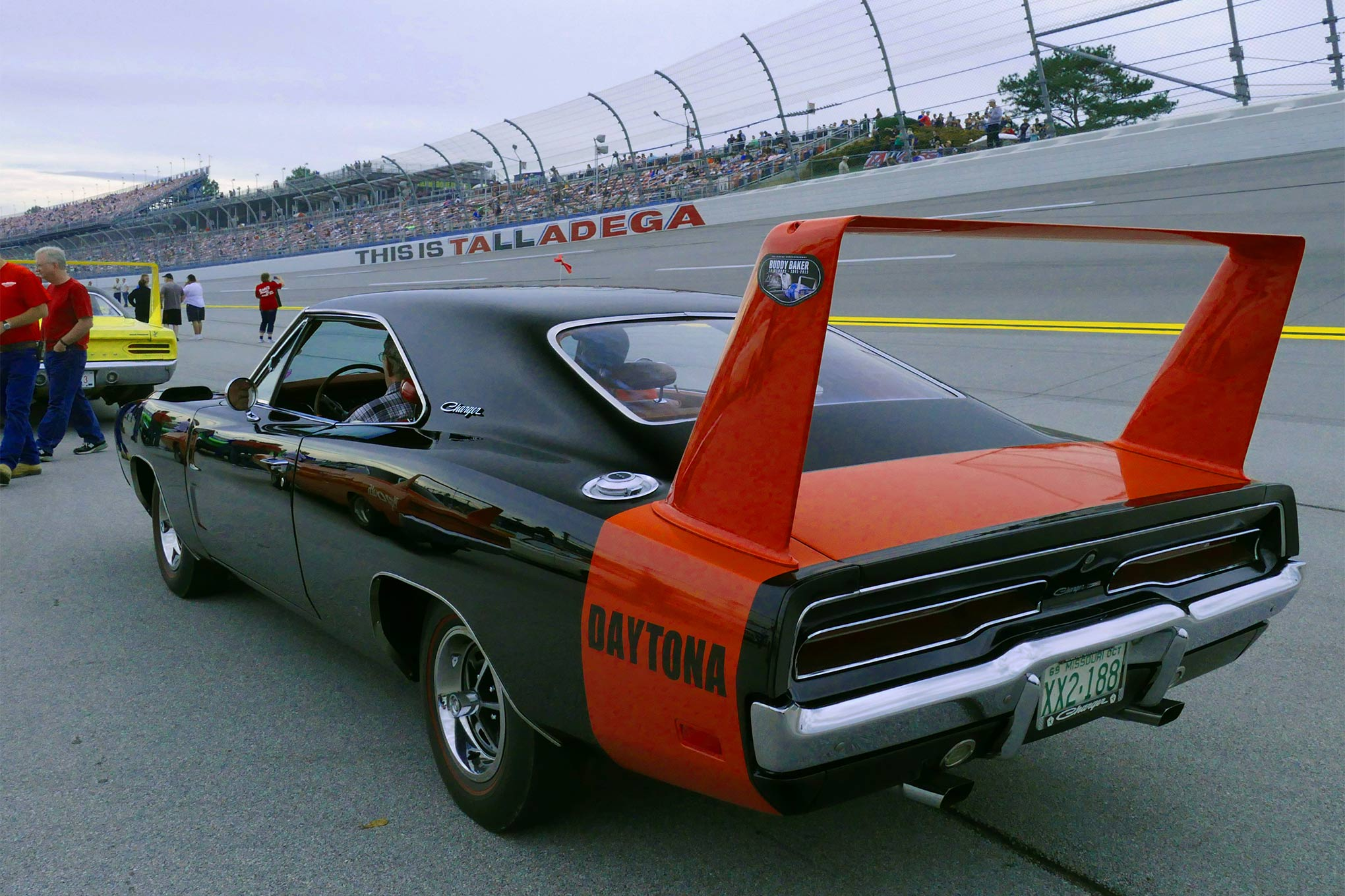 The special Buddy Baker decal is visible on the wing of Jim and Delma McCauley's black Charger Daytona from Montana.