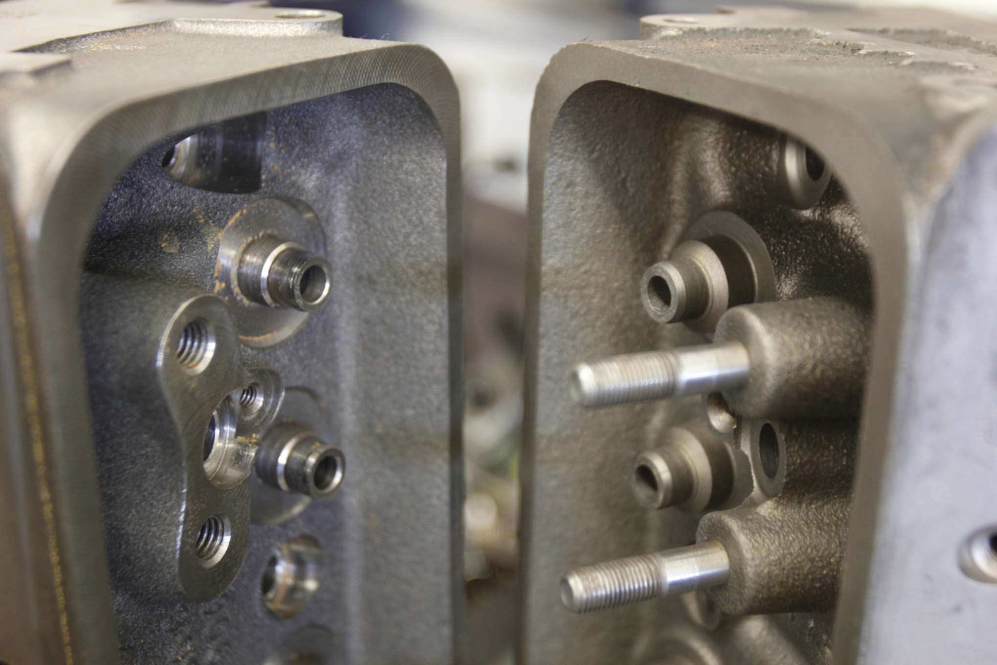 These pictures show the difference in the shape of the valve-guide boss between the Engine Quest cylinder heads and the production Vortec heads. The smaller valve-guide boss won't interfere with the spring retainer at moderate amounts of valve lift. Out of the box, Engine Quest's heads can safely accommodate 0.520-inch lift.