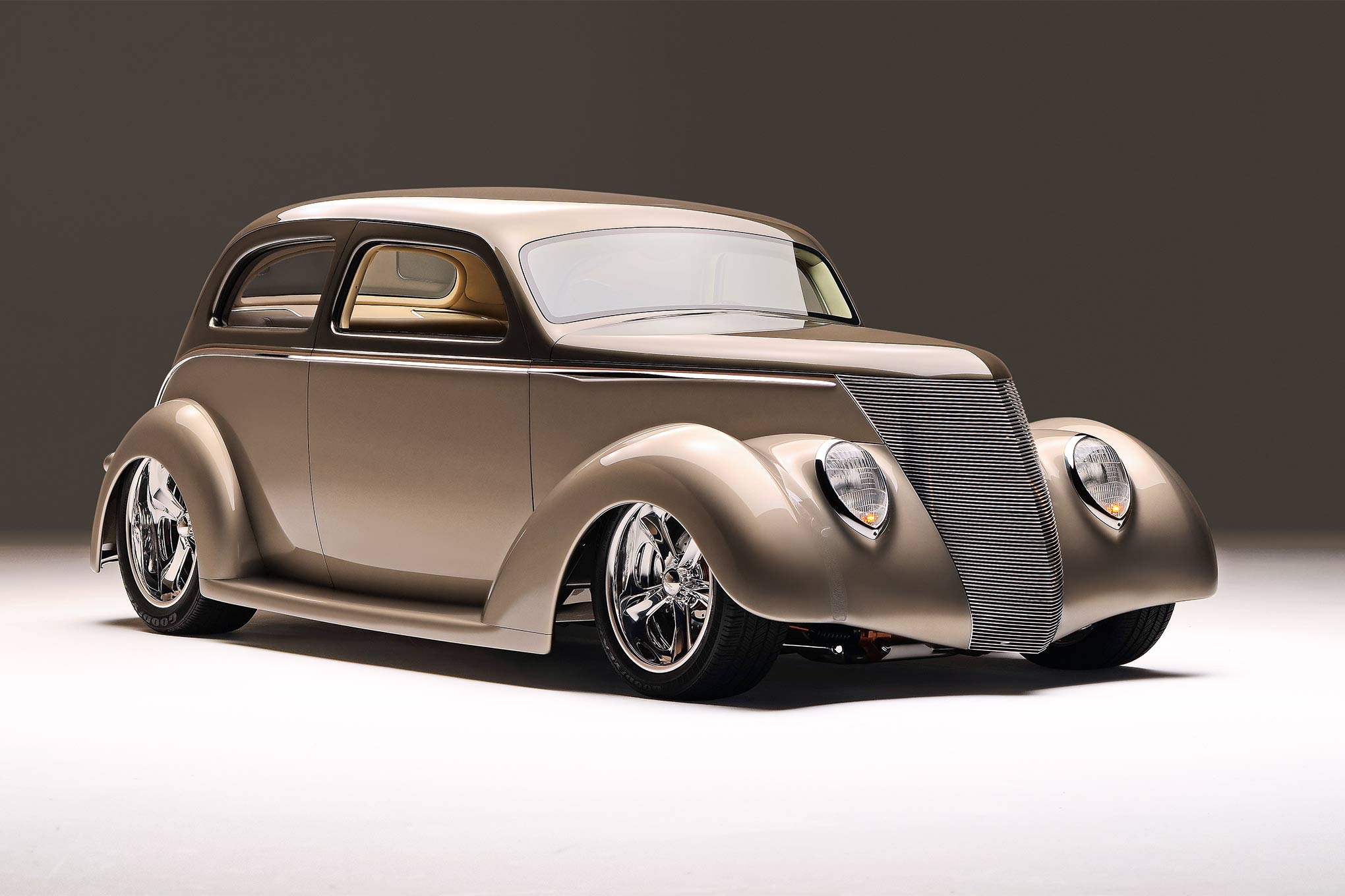 The sedan owes its profile to three people: Jason Rushforth, who called out the car's general shape in renderings, and Charley Hutton and Roy Schmidt, who rendered that shape in metal. They executed the top's distinctive chop by leaning the A-pillars back by 3 inches and the rear panel forward by 4.