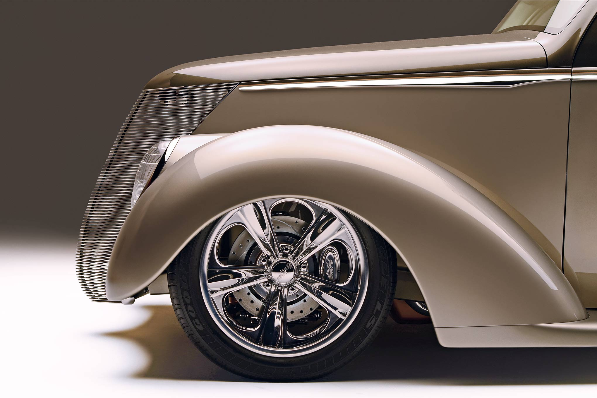 Hutton and Schmidt reshaped  the fender openings to better suit  the wheel's new location. They also laid back the grille and headlight openings along the lines of the A-pillars. The side-trim shape that Eric Brockmeyer designed and Jesse Greening cut mimics the spears Packard made famous on its cars of the '30s and '40s.