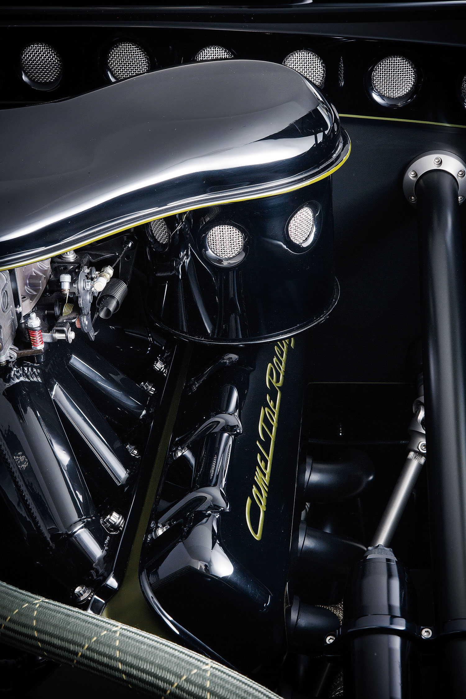 Reminiscent of an early oil bath air cleaner, the Kemp's-fabricated piece is a work of art that grabs the air from the cowl area beneath the windshield.