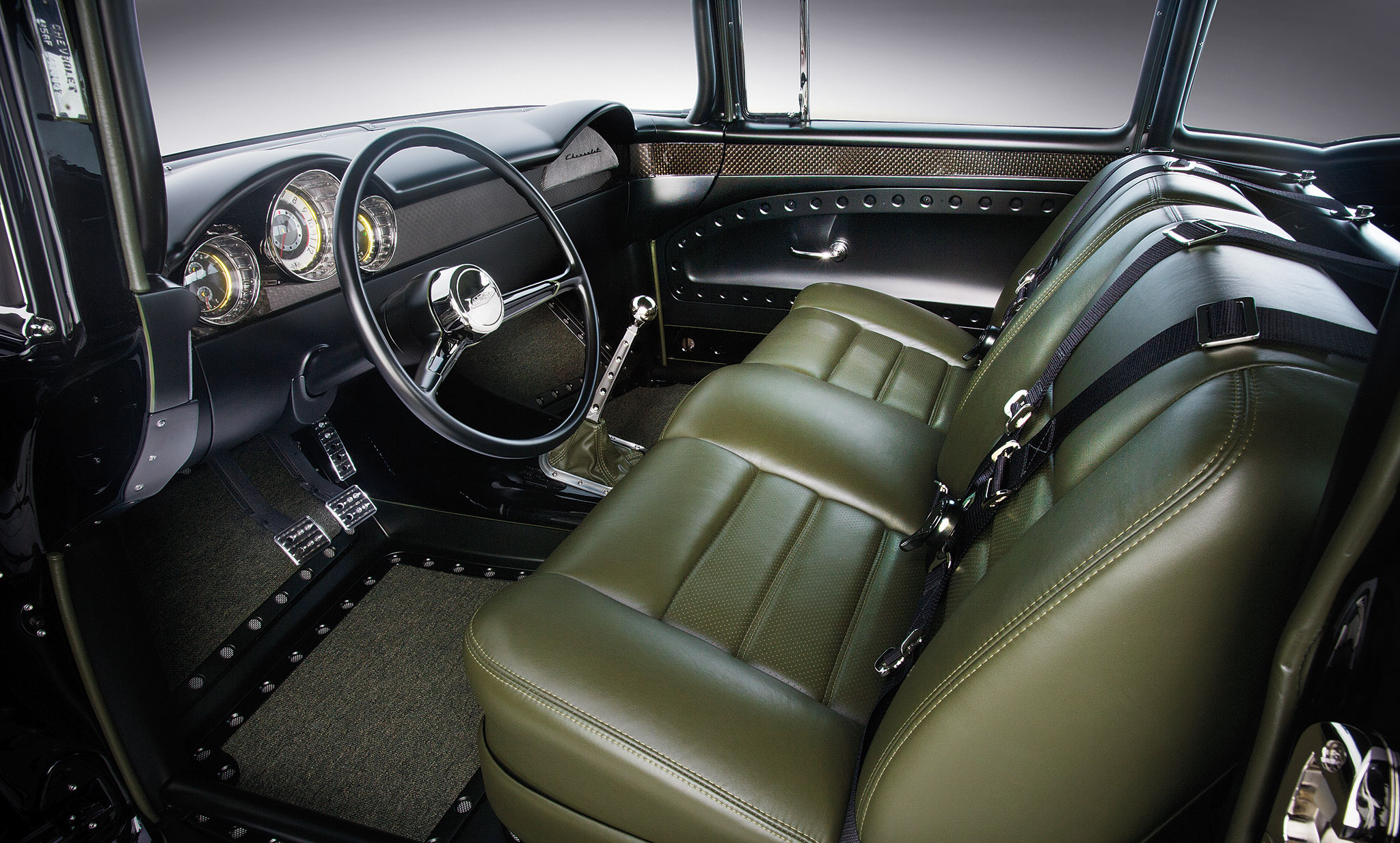 Incredible metalwork can be seen throughout the interior all fabricated at Kemp's. The original '56 bench seat is covered in Tuscan Green leather at Rad Rides by Troy.