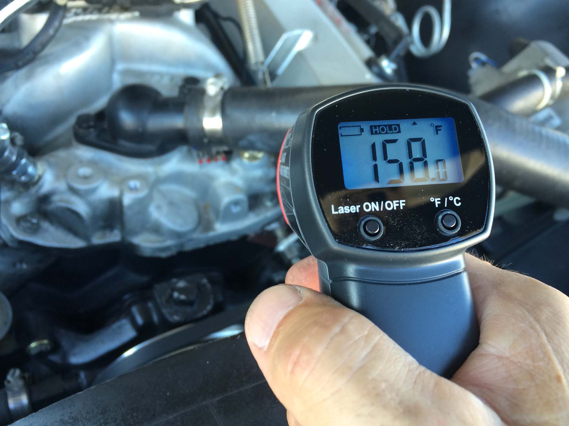We verified the coolant temperature gauge's accuracy with a laser infrared temperature thermometer.