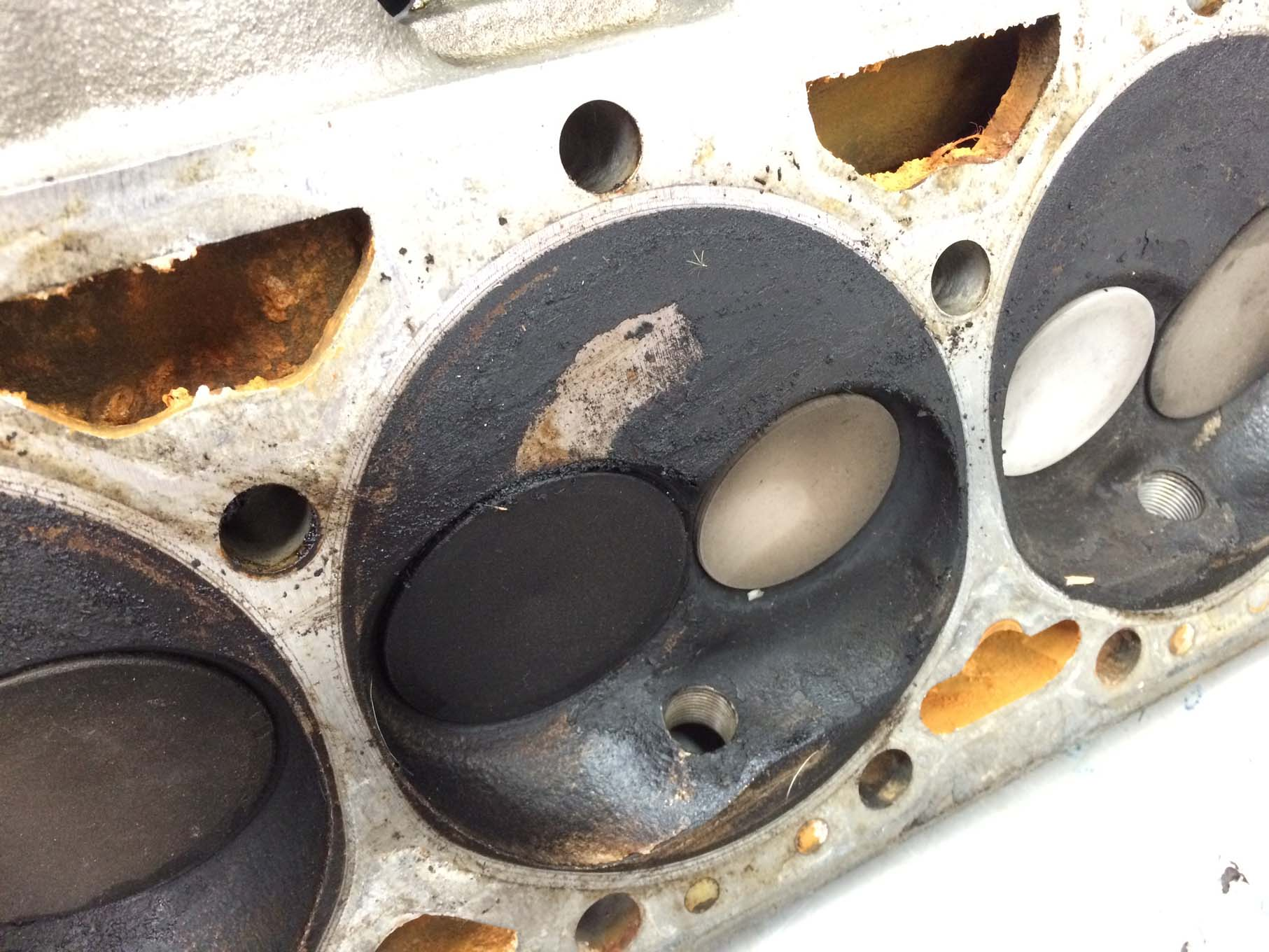 The head gaskets and intake gaskets look like they had been sealing properly, but there was a substantial amount of carbon buildup on the pistons and combustion chambers. This engine looks like it has more than 100,000 miles on it, when we've only driven it for about 5,000.
