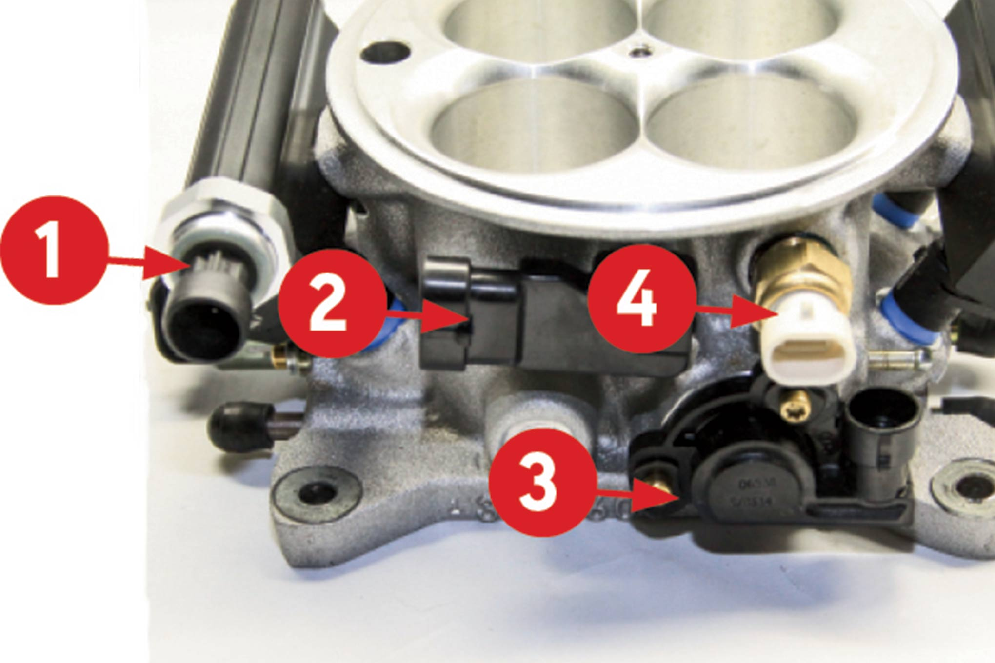 The passenger side of the throttle body mounts (left to right) the pressure sensor in the fuel rail (1), manifold absolute pressure sensor (2), throttle position sensor (3), and the manifold air temperature sensor (4).