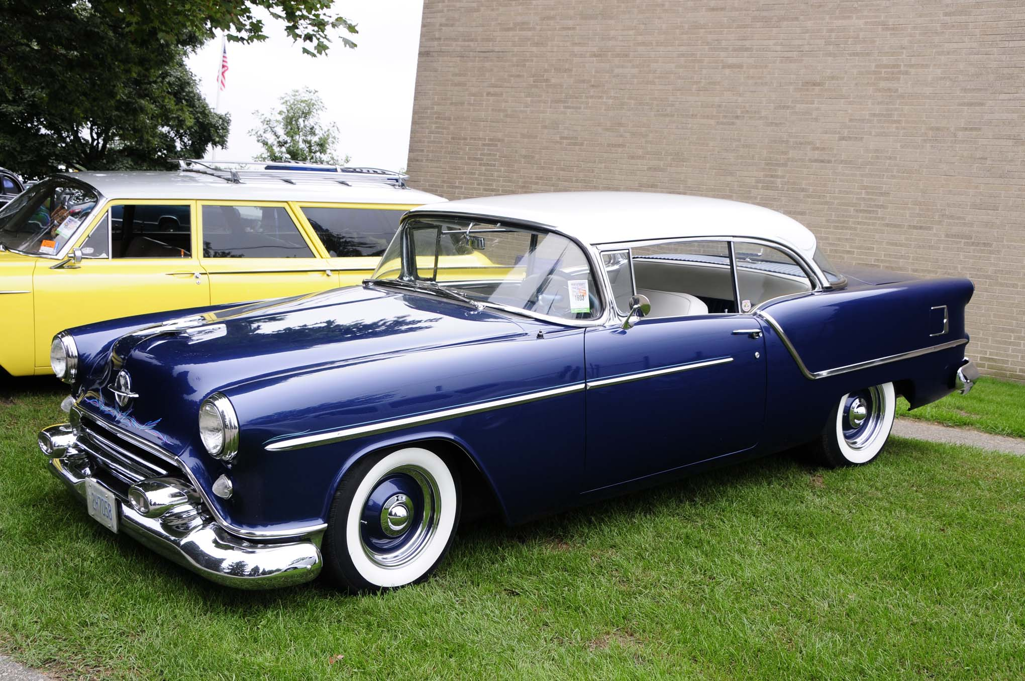 Nothing cruises better than a mild custom like this subtle 1954 Oldsmobile owned by Ray Jervis with its lowered stance, deep blue gloss, and steelies with wide whites.