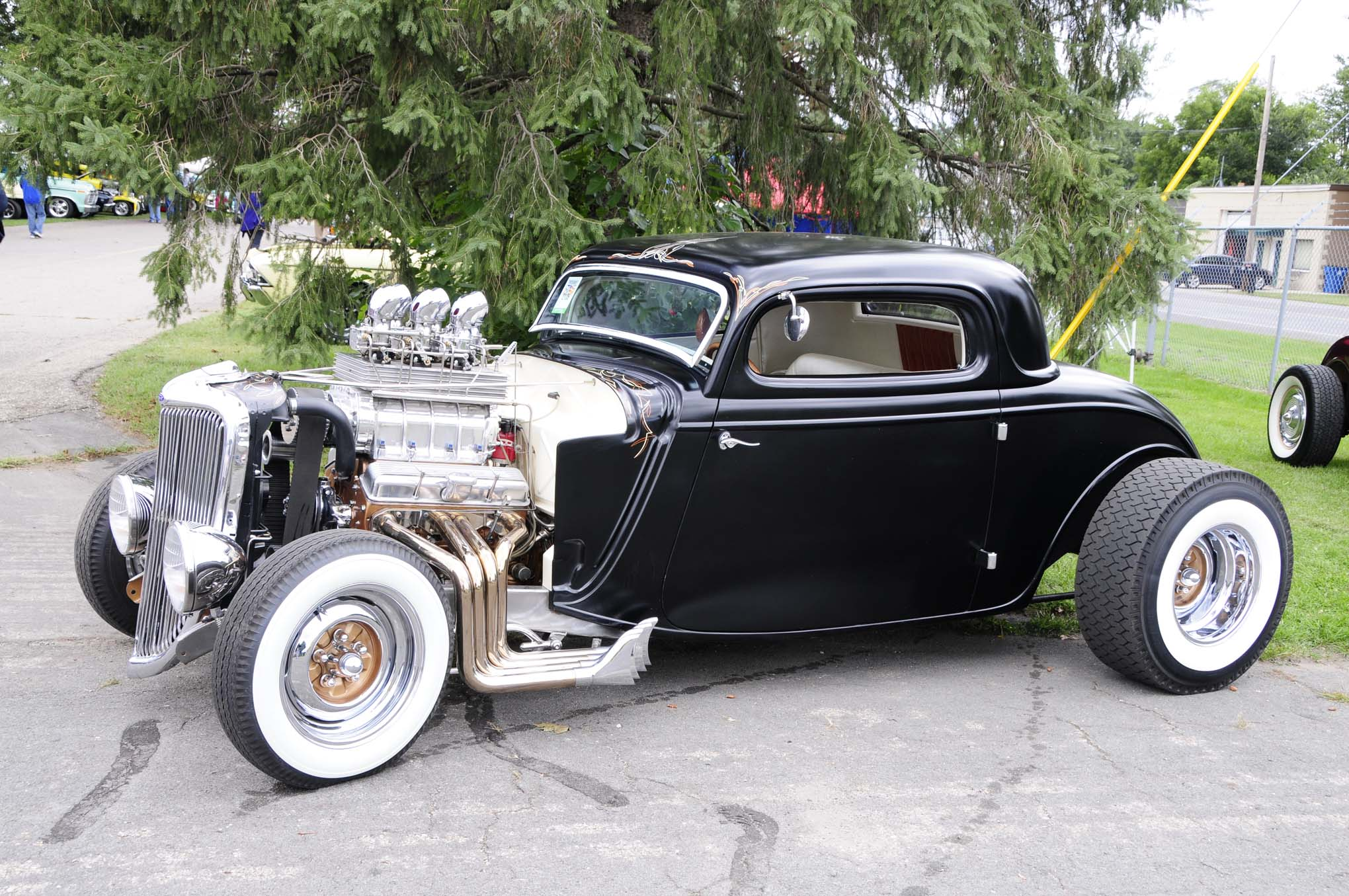 Chopped, channeled, and coated in polished black suede and spinning cheater slicks, Aaron Bunch's 1934 Ford packed a huffed six-deuce fed small-block for power.