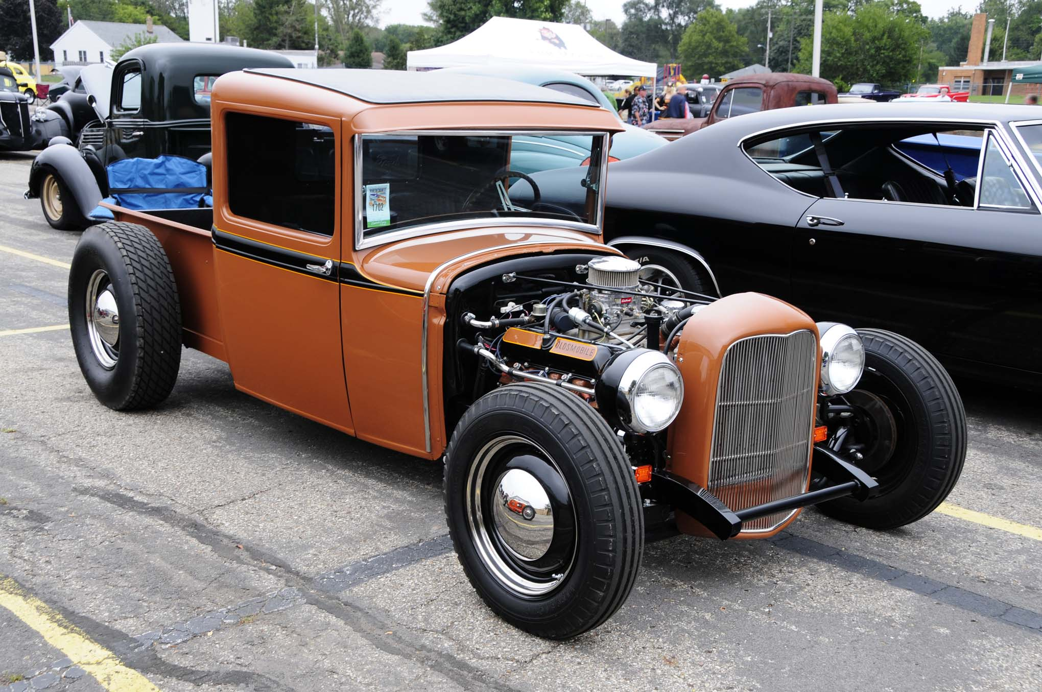 We really dig Bob Oland's 1931 Ford hauler with its channeled body, chopped Deuce grille, Oldsmobile V-8 power, and perfect rim and tire combination.