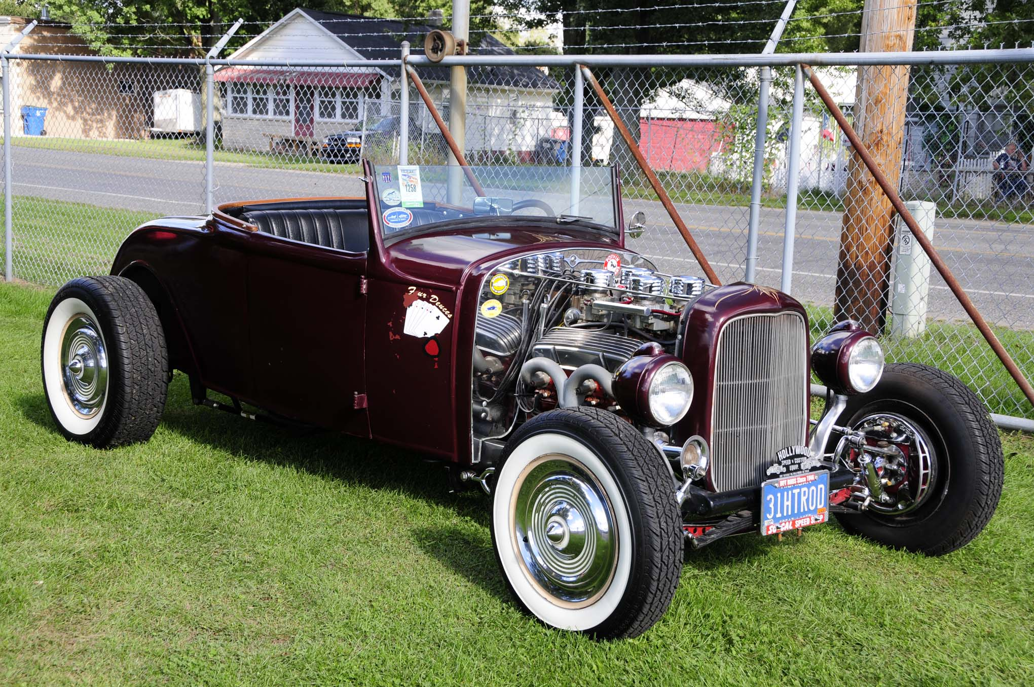 Tom Calvey's 1931 Ford roadster was packed with all the right bits, including a four-deuce-fed small-block, channeled body, chopped windshield, and deep burgundy pearl body.