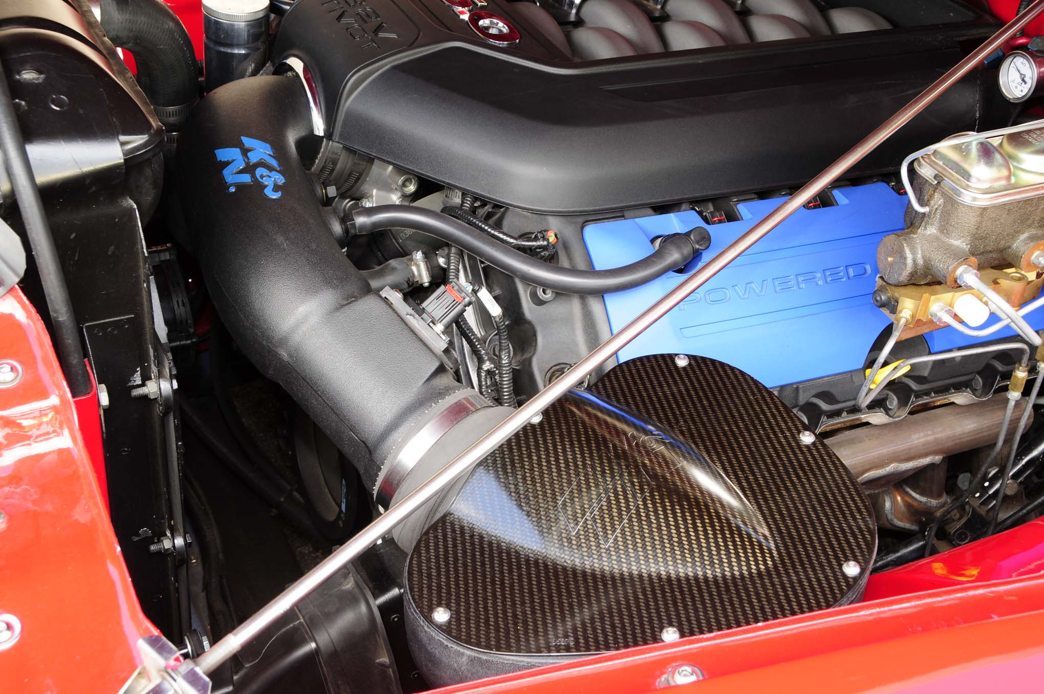 A K&N cold air intake with carbon-fiber accents adds just a bit of racy detail to the engine as well as increase performance.