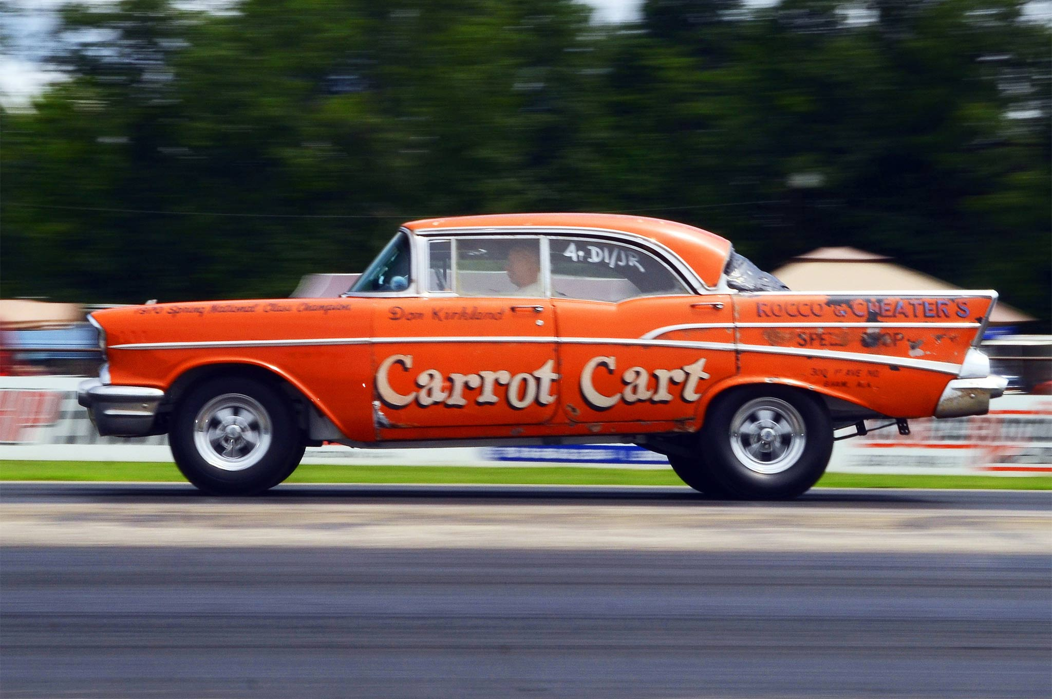 "Don Kirkland bought the Carrot Cart back in 1968 for $40; he ran it with a 220hp 283 in N/S and later, with a ""good engine"" he got from Pennsylvanian Lee Crupi, he ran O/S and won class at the 1970 Springnationals in Dallas. After the 15-year-rule occurred, the car literally went out to pasture and Don raced others. More than 40 years on, he dug it out. When he and wife Debbie arrived from Alabama, there was a bag covering the back window and the paint showed its age, but he told us his highlight for the weekend was getting a rear axle in place that let him drive it under power for the first time in decades and the graciousness of Beaver Bob to let him make a lap on Sunday, the car's first in 44 years."