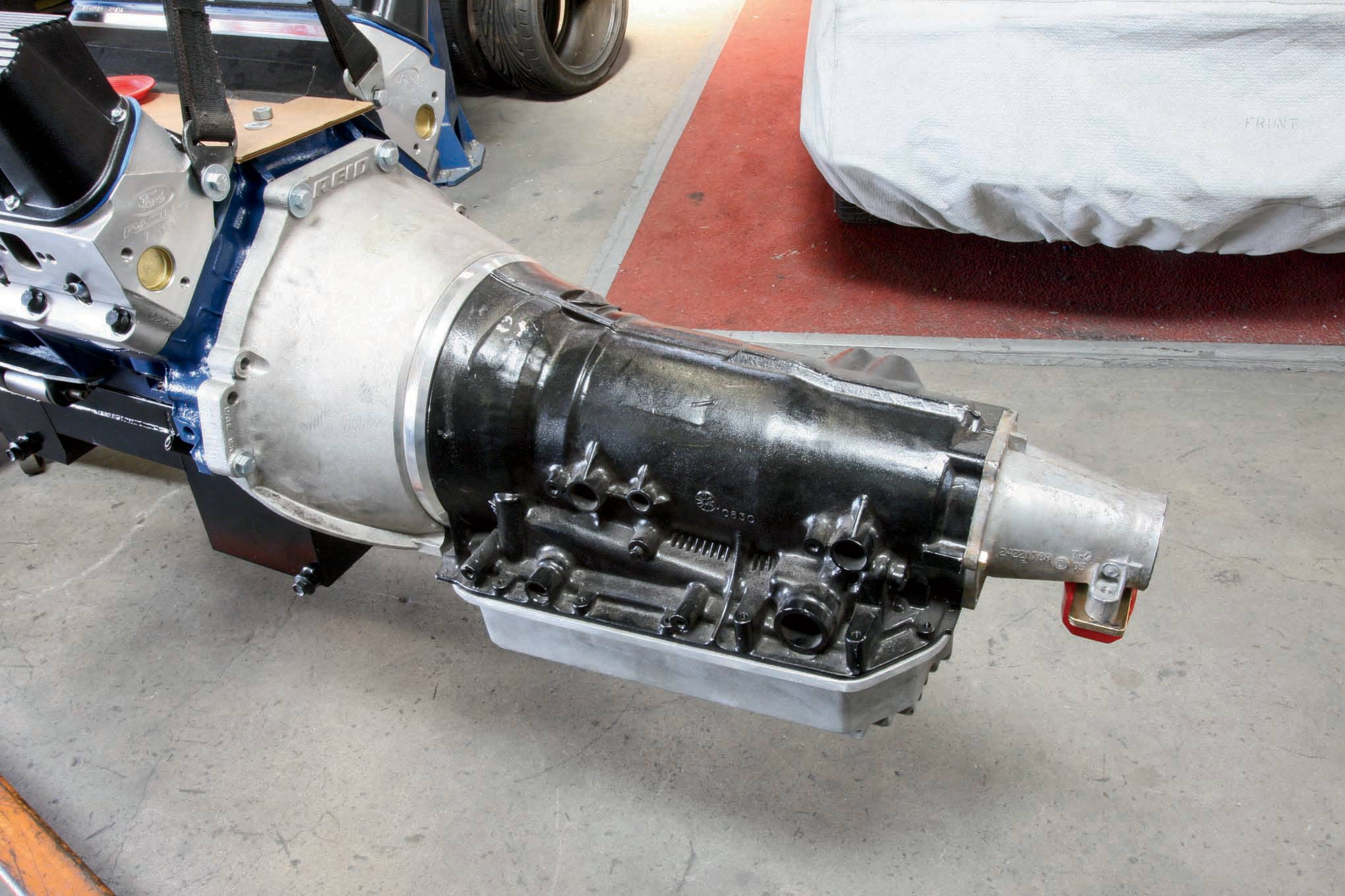 If you think that's a GM transmission hanging on the back of our Ford BOSS 427, you're right. It's a 4L80E from Hughes.