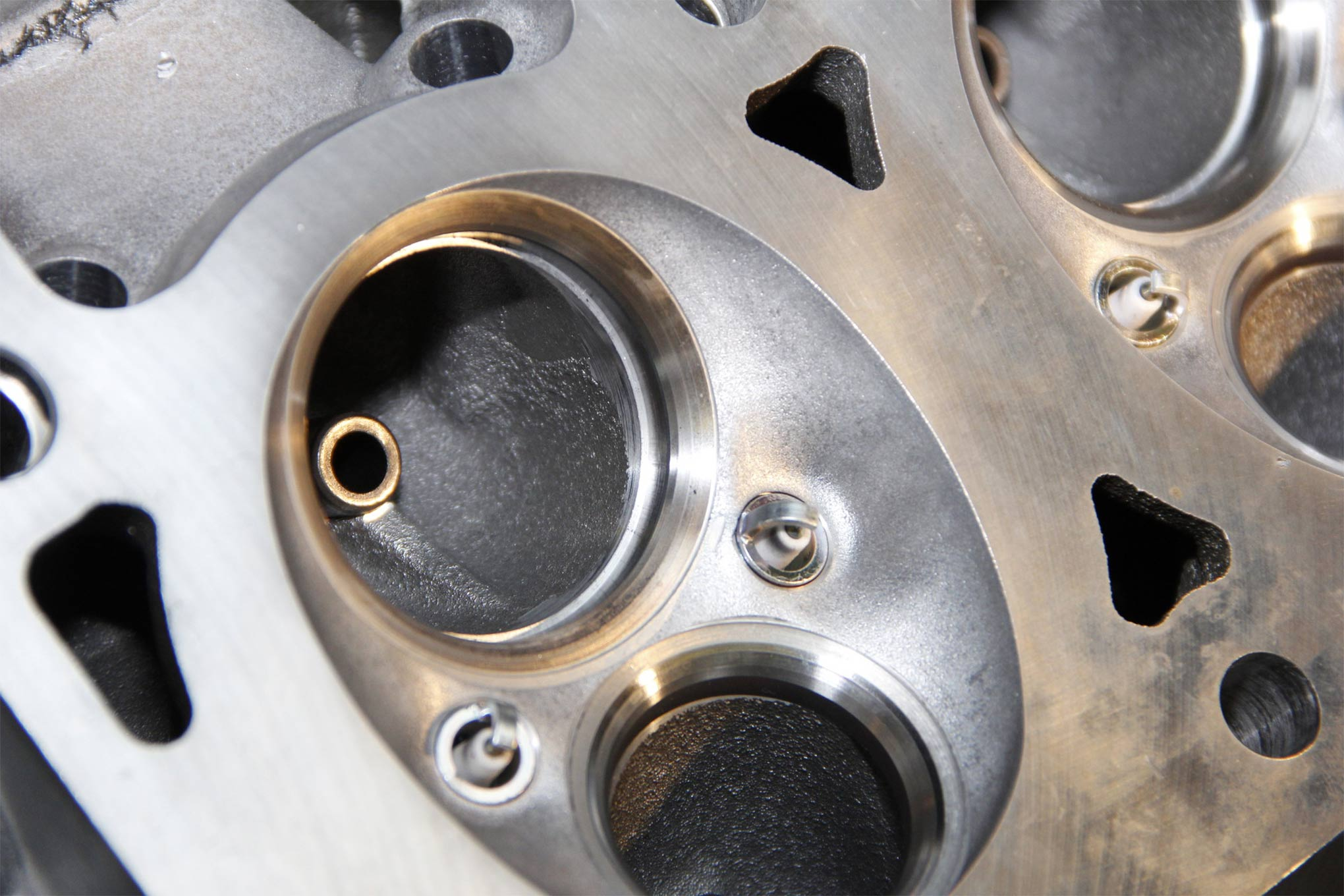 1. The stock Hemi valve seat is the choke point for flow. To fix this, bore the ID of the valve seat to 85-92 percent of the valve diameter and add a five-angle cut to the seat.