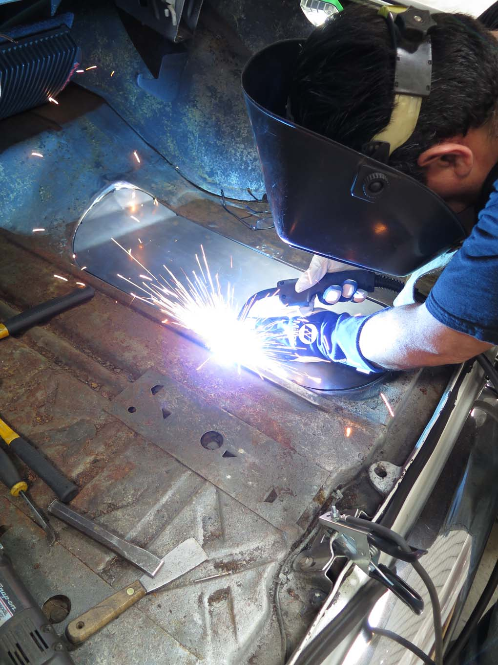 Rather than drill and plug weld the filler panel, as it sits in a stepped flange, it was simply tack-welded around the edge.