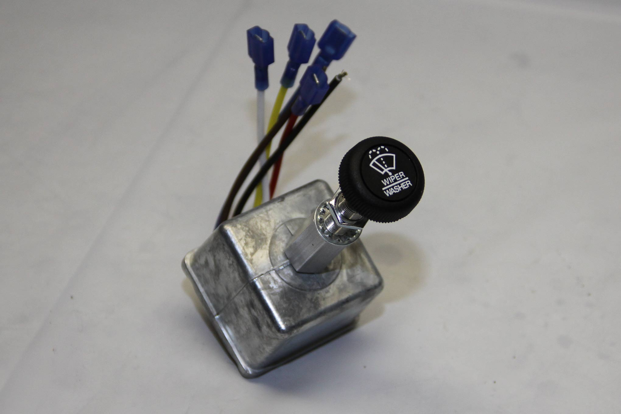 We opted for the intermittent wiper delay switch. It can also operate a windshield washer pump.