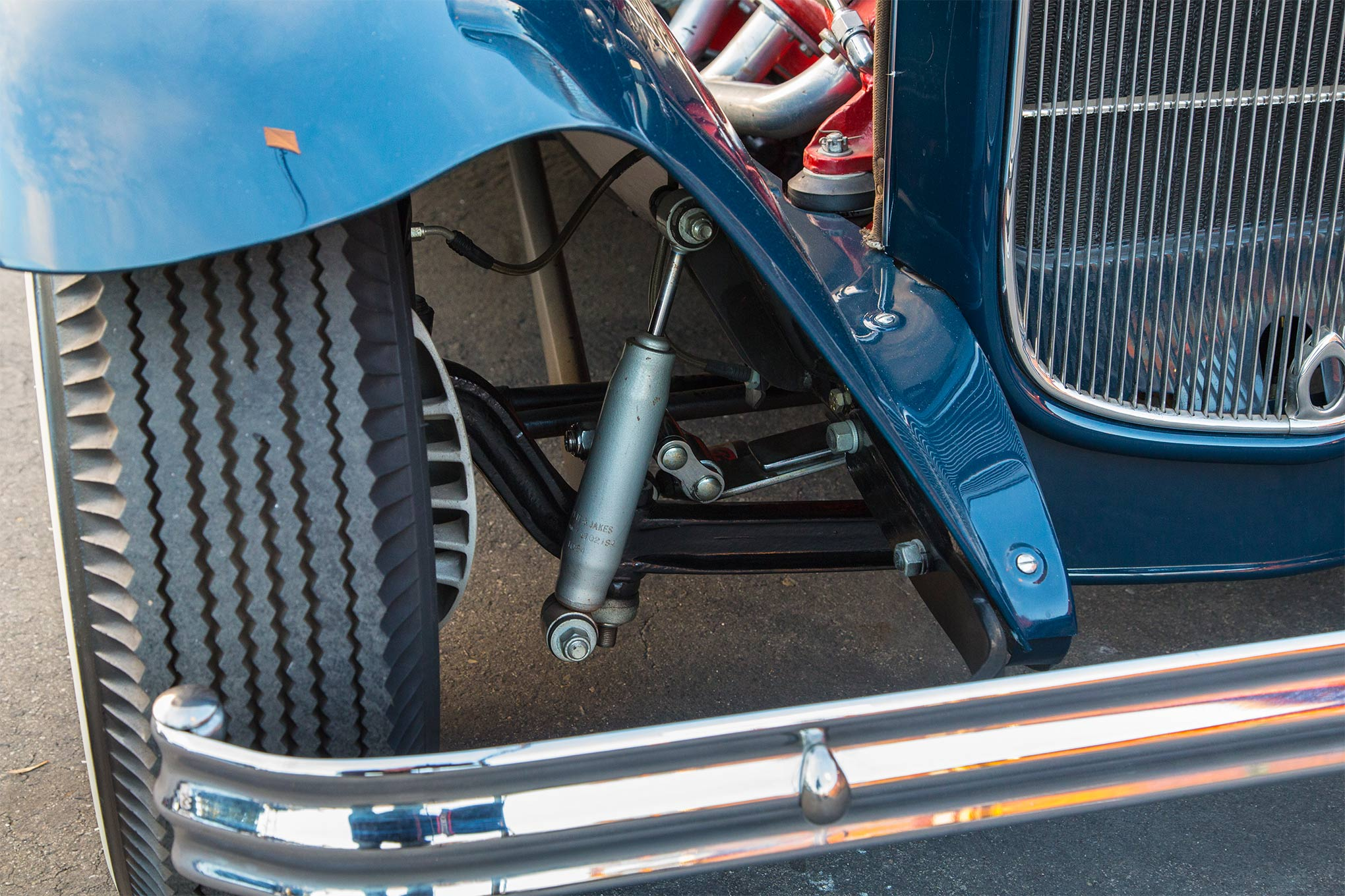 A 4-inch-dropped Model A axle is hung with split wishbones. The finned scoop peeking out from behind the tire isn't for a Buick brake drum but for a set of Functional Fakes from Deuce Manufacturing, aluminum covers that mimic the look of the iconic Buick binder but instead house contemporary disc brakes.