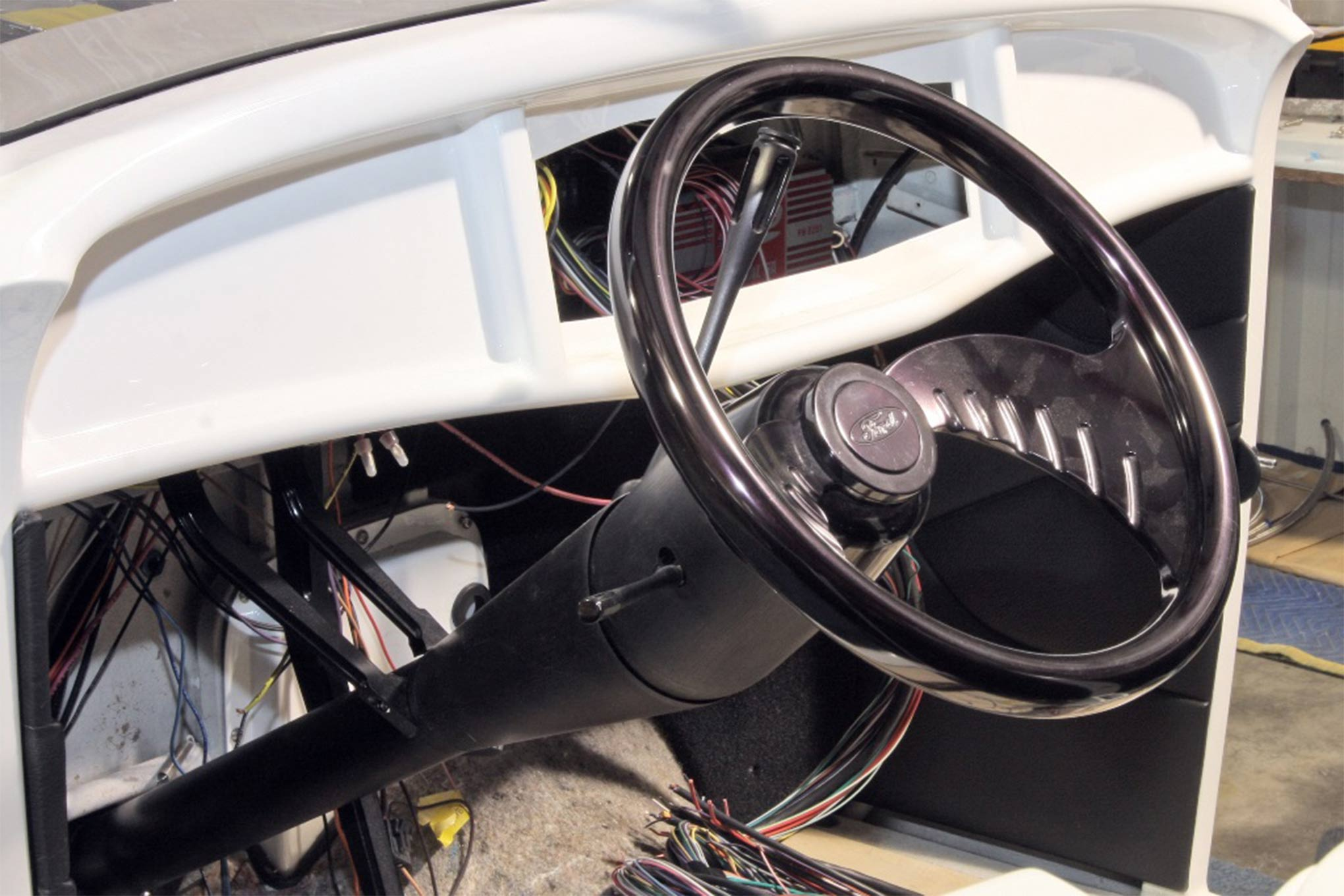 A three-spoke steering wheel dressed up the interior 27 years ago. This wheel was on the roadster when we visited it recently.