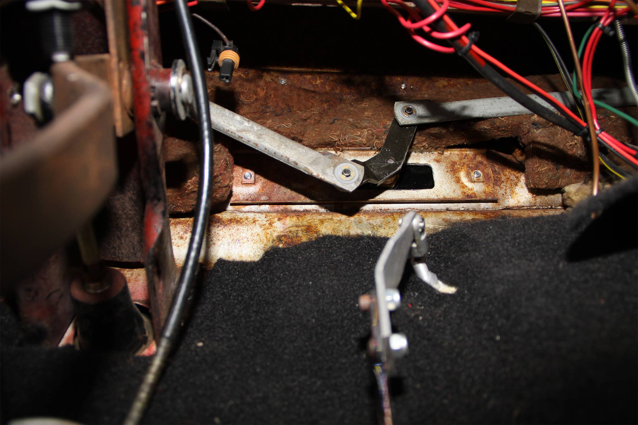 On the passenger compartment side of the firewall the original linkage arms are equipped with replacement bushings, attached to the motor and secured with C-clips.