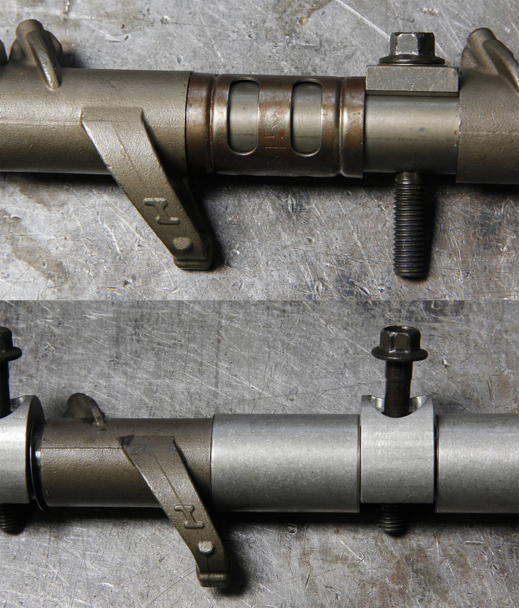 7. The factory rocker shafts allow the rocker arms to move laterally, bouncing between the spark plug boss and the rocker shaft tower. To fix this, an aluminum sleeve with steel shims and a new stand is added to get the correct clearance and stability.