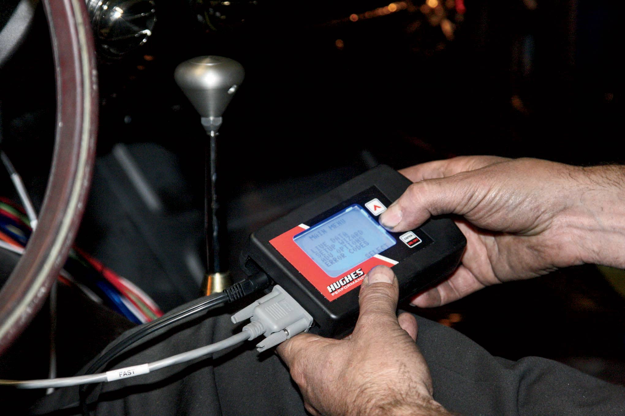 Programing the transmission's electronic control module does not require a lap top computer—it's done with a small hand-held unit Hughes supplies.