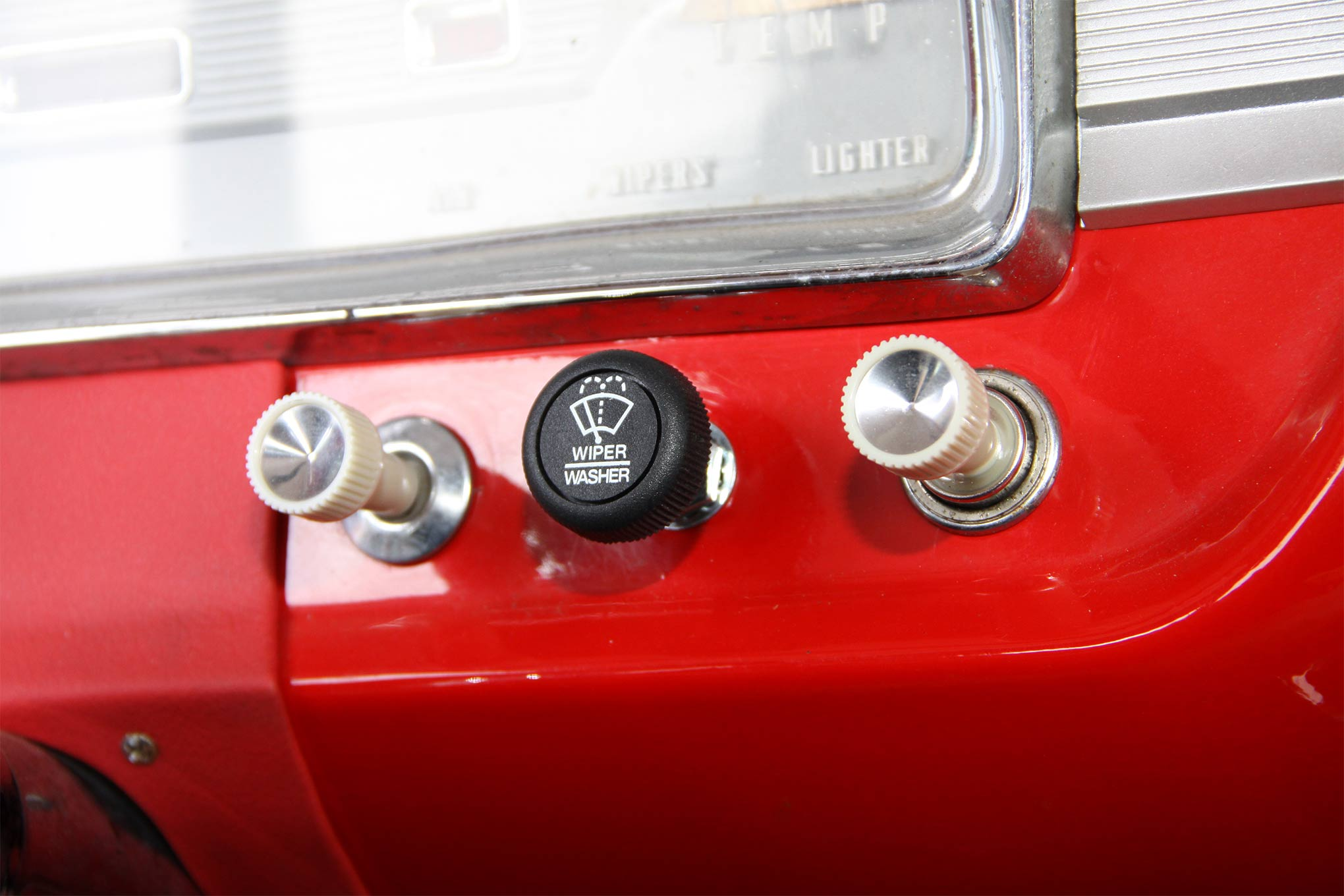 The new washer switch replaces the original. The stock knob wiper knob had been damaged—the plans are to find a replacement.