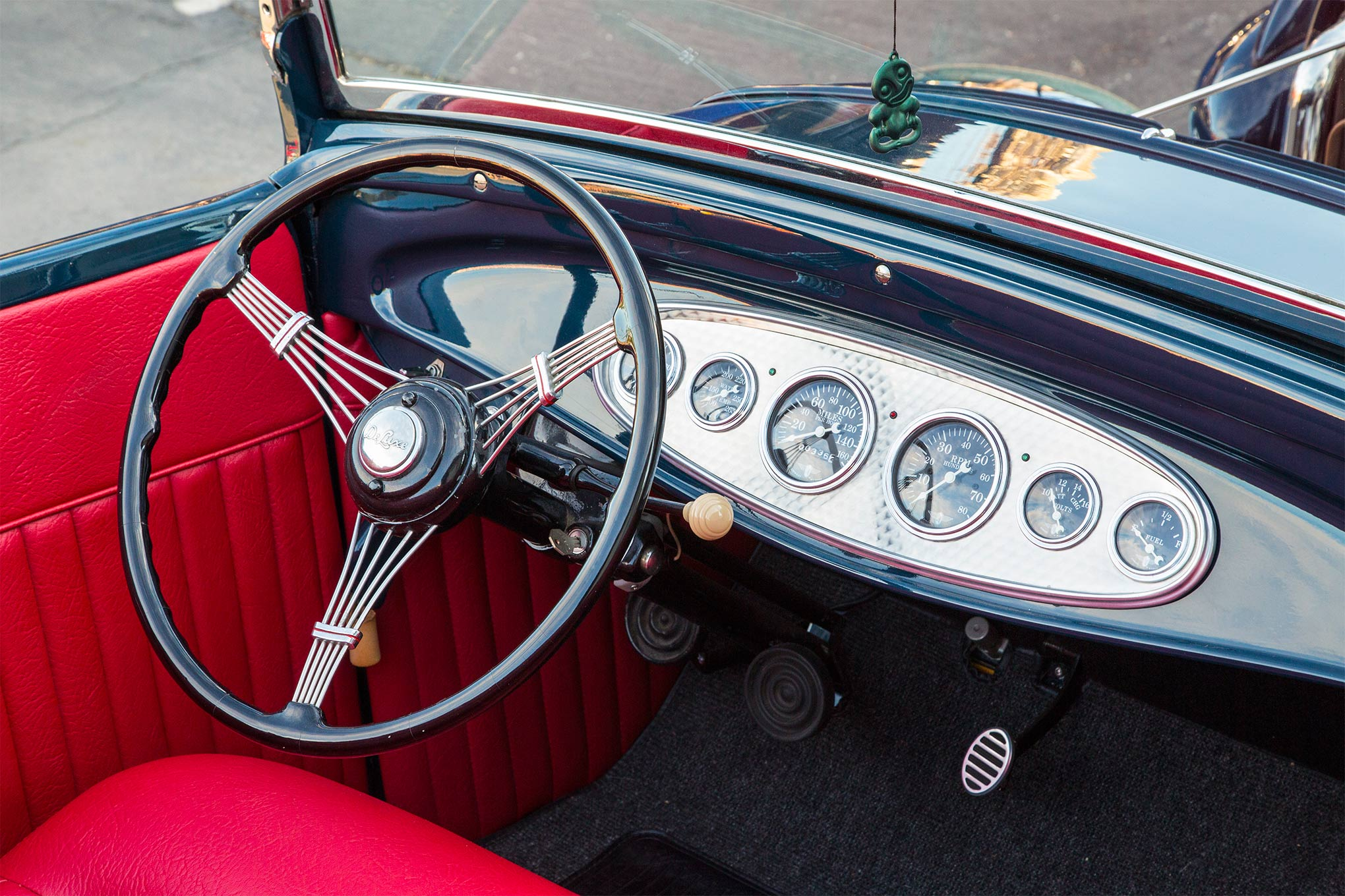The '32 dashboard is home to Stewart-Warner curved-glass gauges. A '39 Ford banjo wheel is attached to a '46 Ford truck column. Steve put together the column shift mechanism, as he didn't want a shifter on the floor.