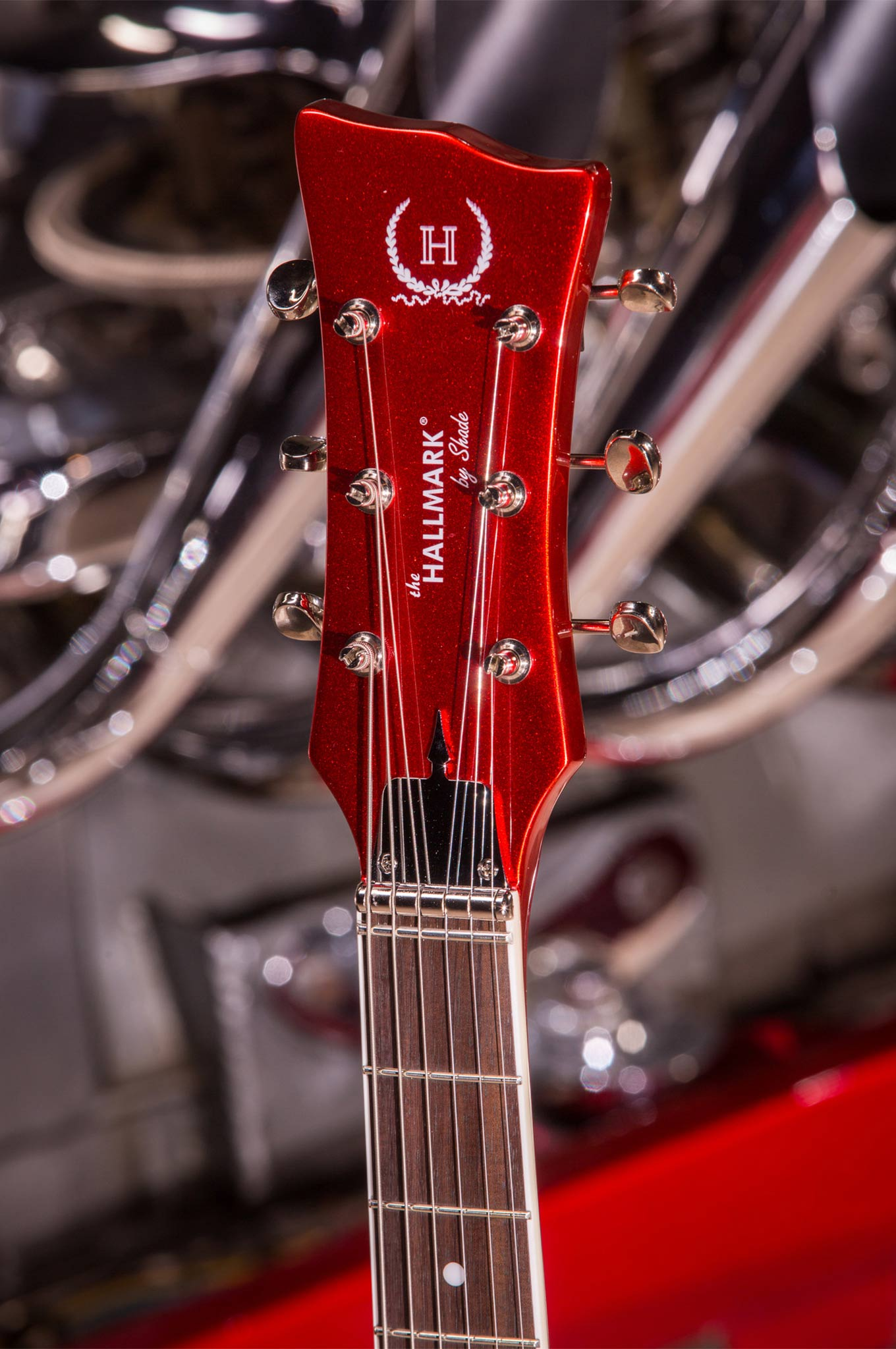 Details that mimic the car are all over the guitar. See the helmet spike?