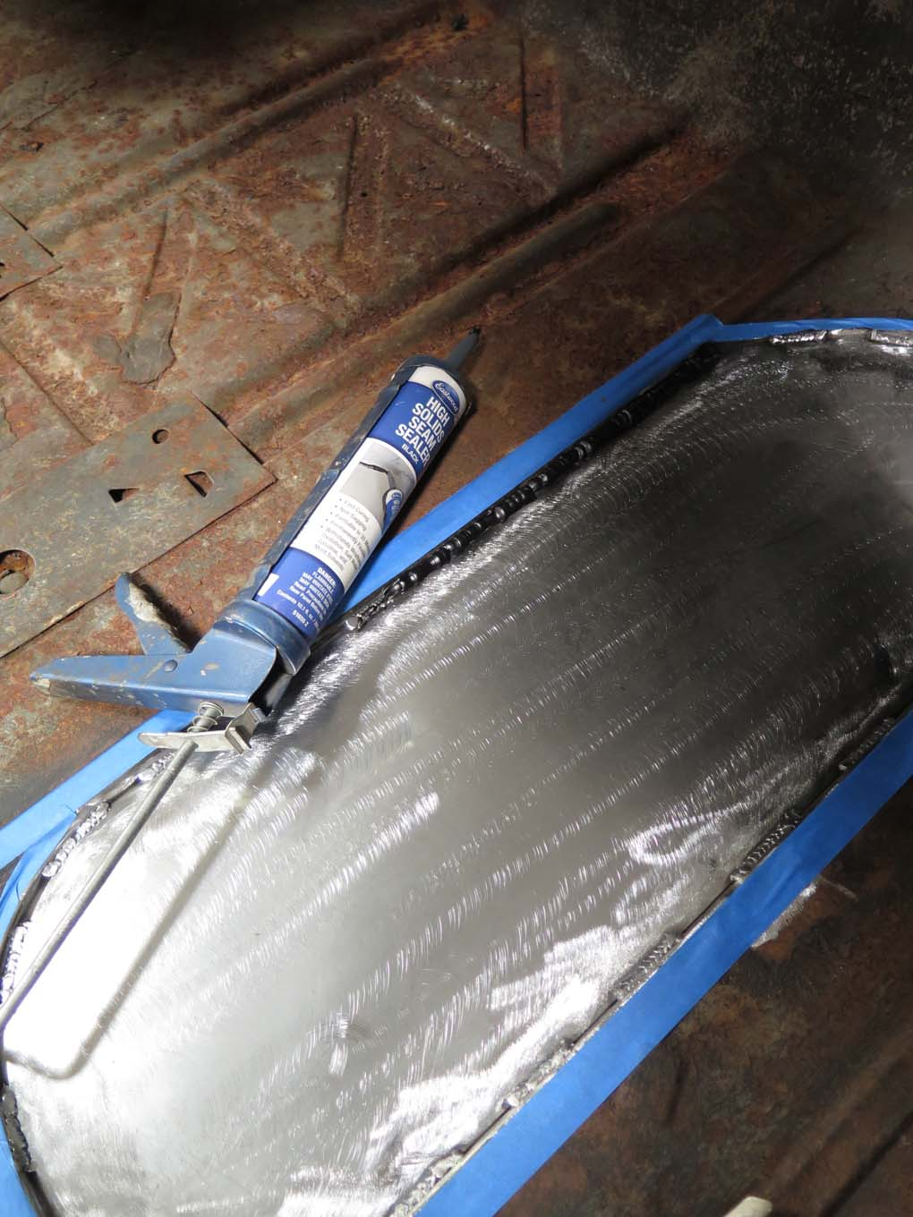 Eastwood high solid seam sealer was used to seal the perimeter. Note the short sections of weld rather than just tacks. The sealer will prevent moisture and rust in the joint.