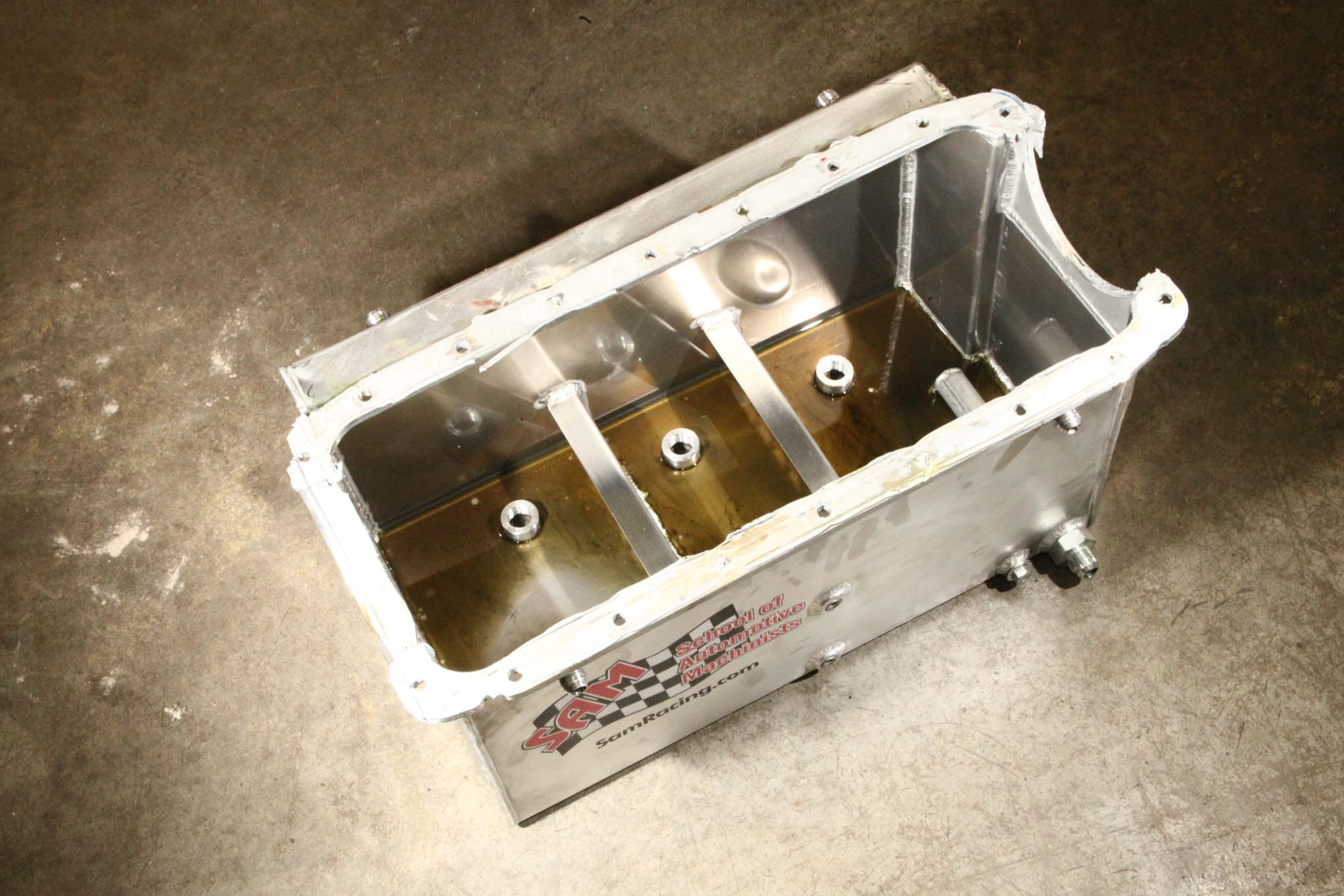 The AMSOIL Engine Masters Challenge rulebook doesn't mandate a passenger car oil pan—although the use of one is certainly in the spirit of the competition. This freed SAM to use this deep unit. Despite its huge capacity, the goal is not to run tons of oil; the seven quarts of AMSOIL synthetic settles in the pan nearly half a foot away from the commotion of the crank where it cannot cause drag.