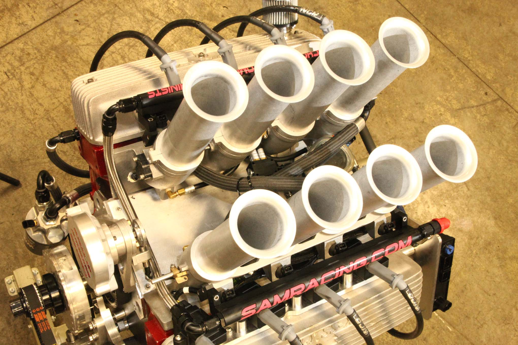 Though a number of factory and aftermarket 4-bbl, 3x2, and 2x4 intake manifolds exist for the Poly, they're mostly obsolete vintage items. Then the SAM team noticed the Gen III Chevy V8 has nearly identical port spacing. This opened the door to a Hilborn LS7 individual-runner EFI casting. Hilborn's three-piece construction simplified the adaptation process.