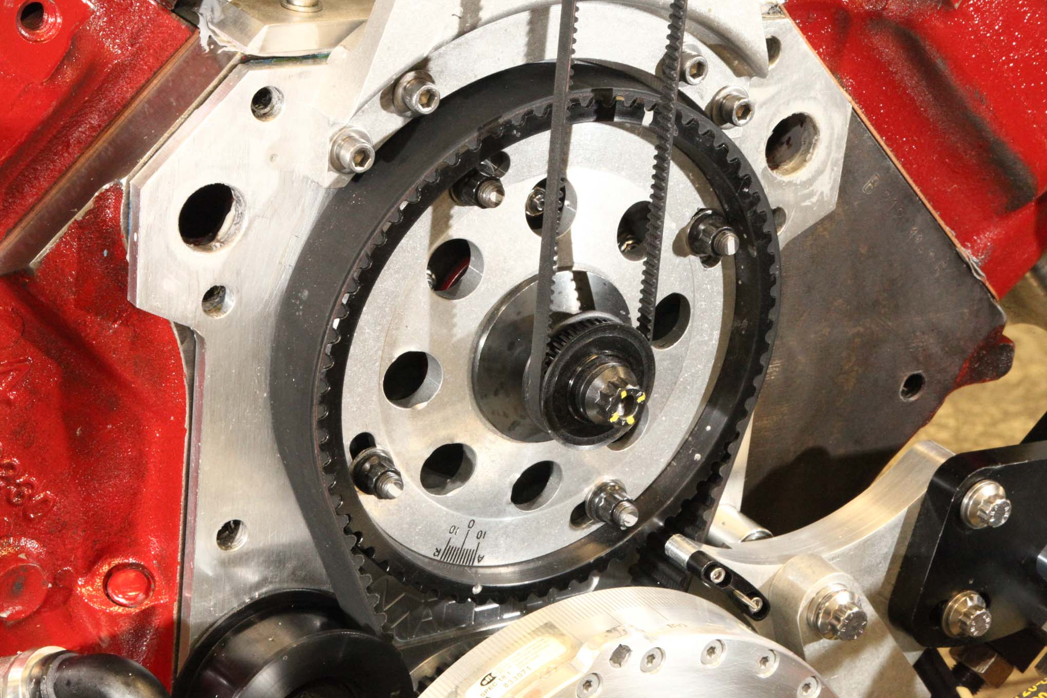 The belt-driven cam allows fast, accurate cam phasing adjustments while sapping less energy than any chain or gear drive. The tiny Gilmer belt is part of the totally reconfigured Pro Stock-spec ignition drive system.